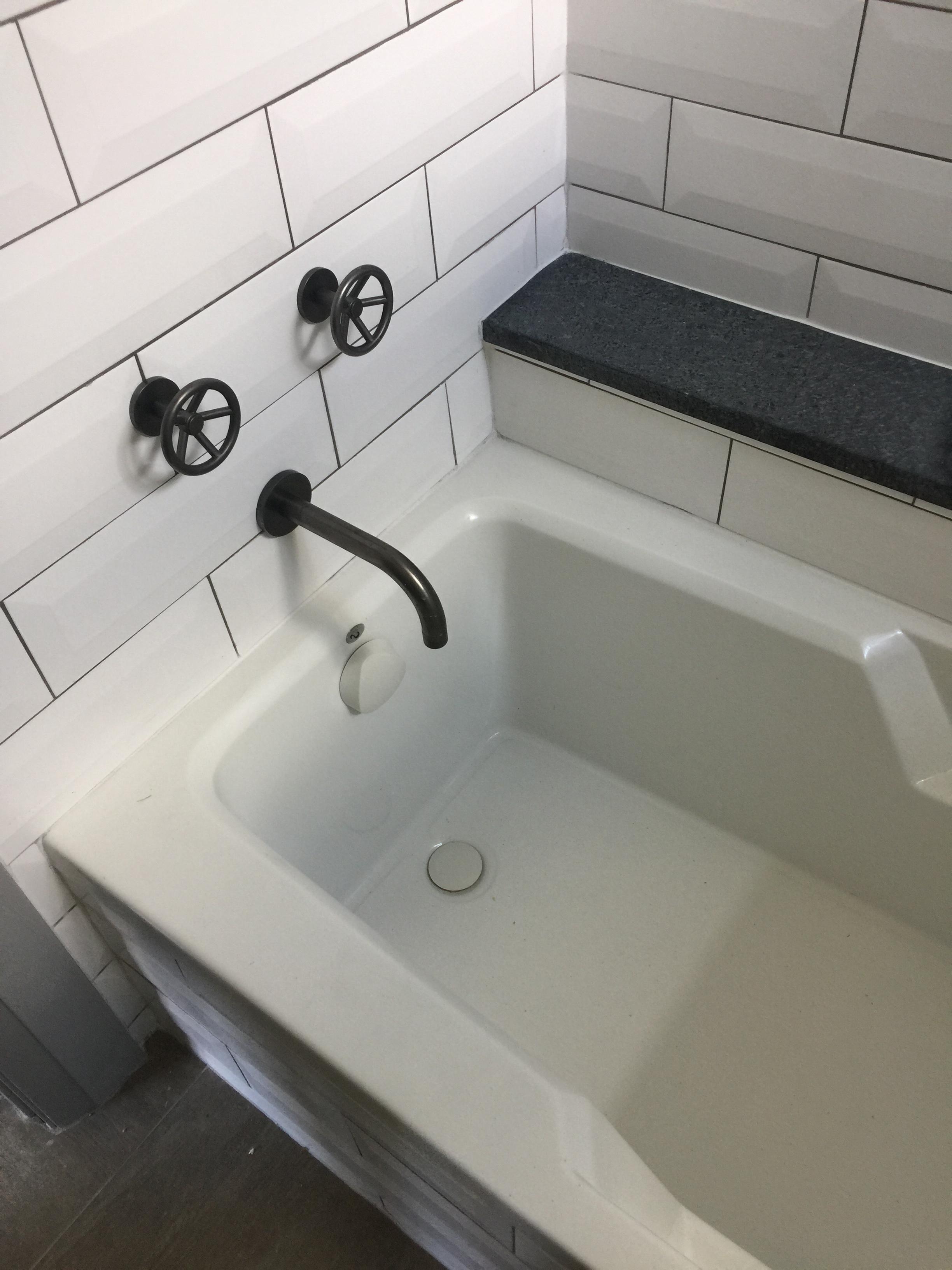 Cool faucet handles in the boy's bathroom tub - Shundra Harris Designer
