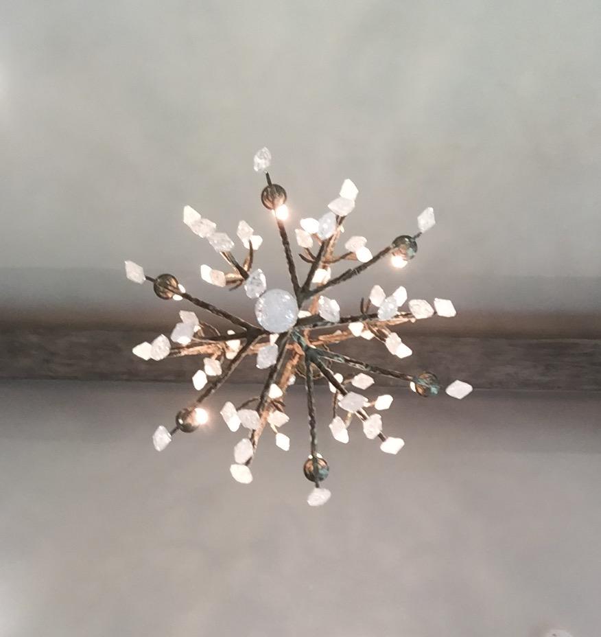 Rock crystal chandelier in the master bedroom - Designed by Donna Vining