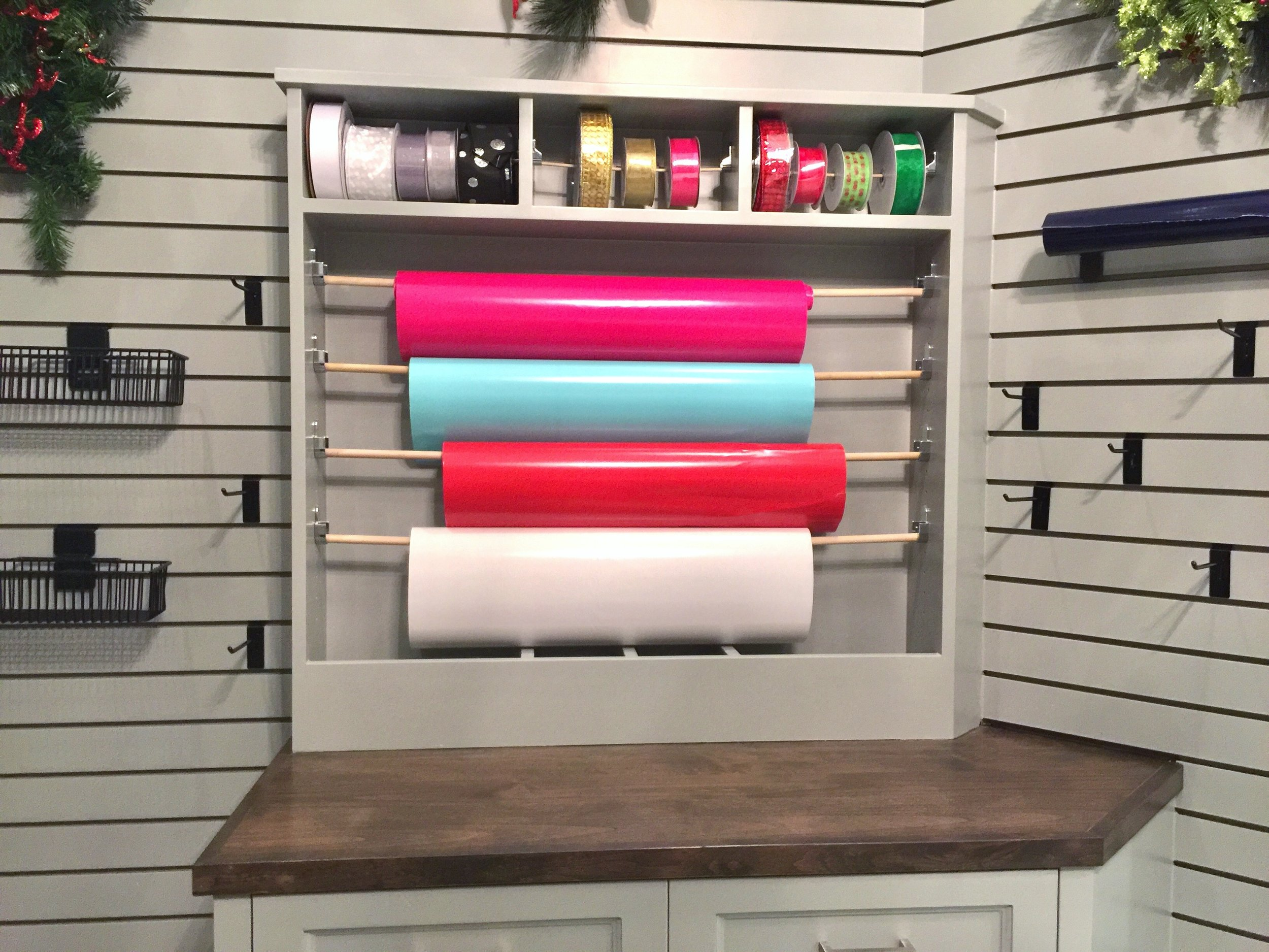 Gift wrap center in holiday storage room - Peterson Homebuilders