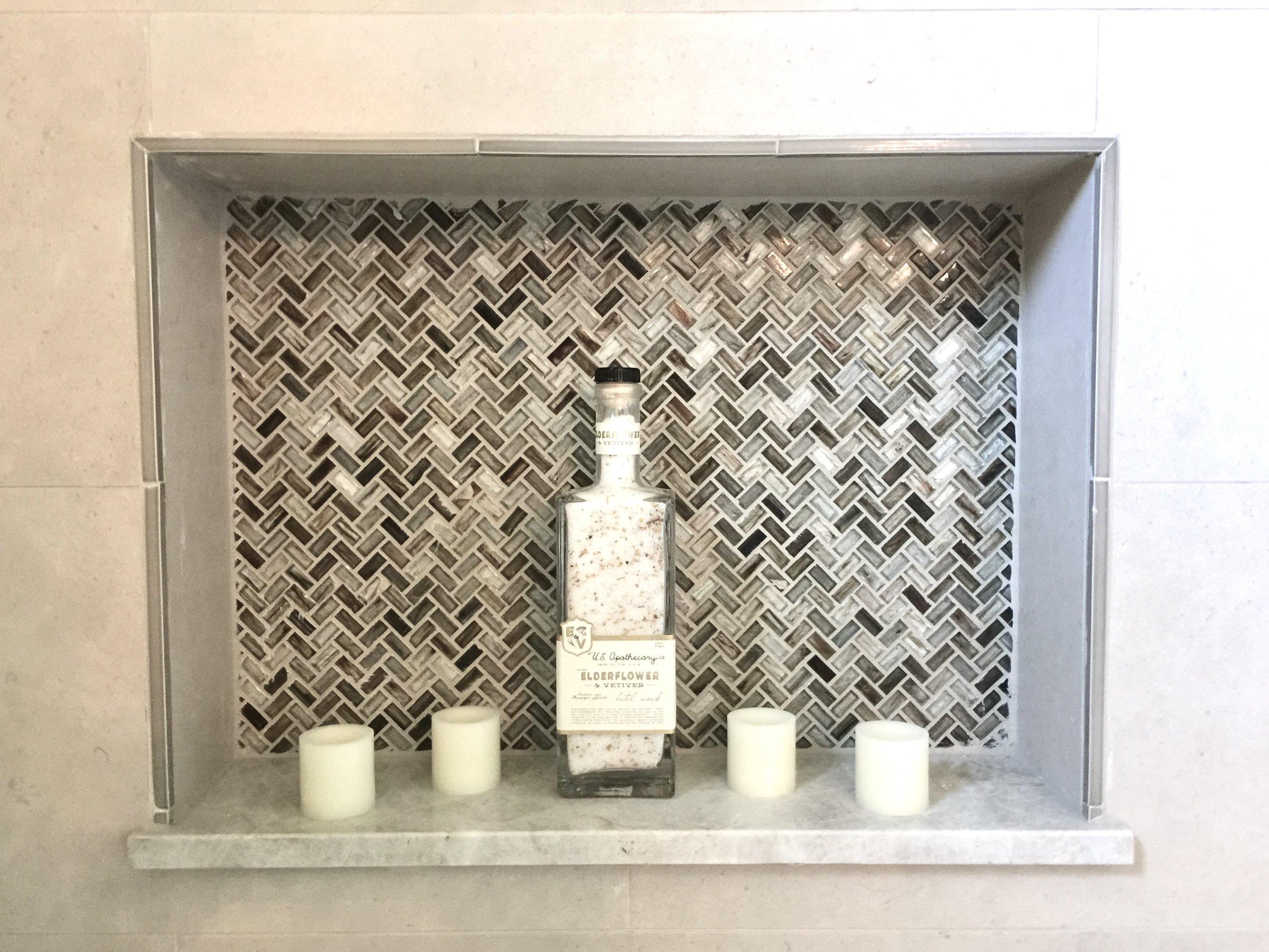 Shampoo niche with marble shelf in bathroom designed by Cristina Robinson
