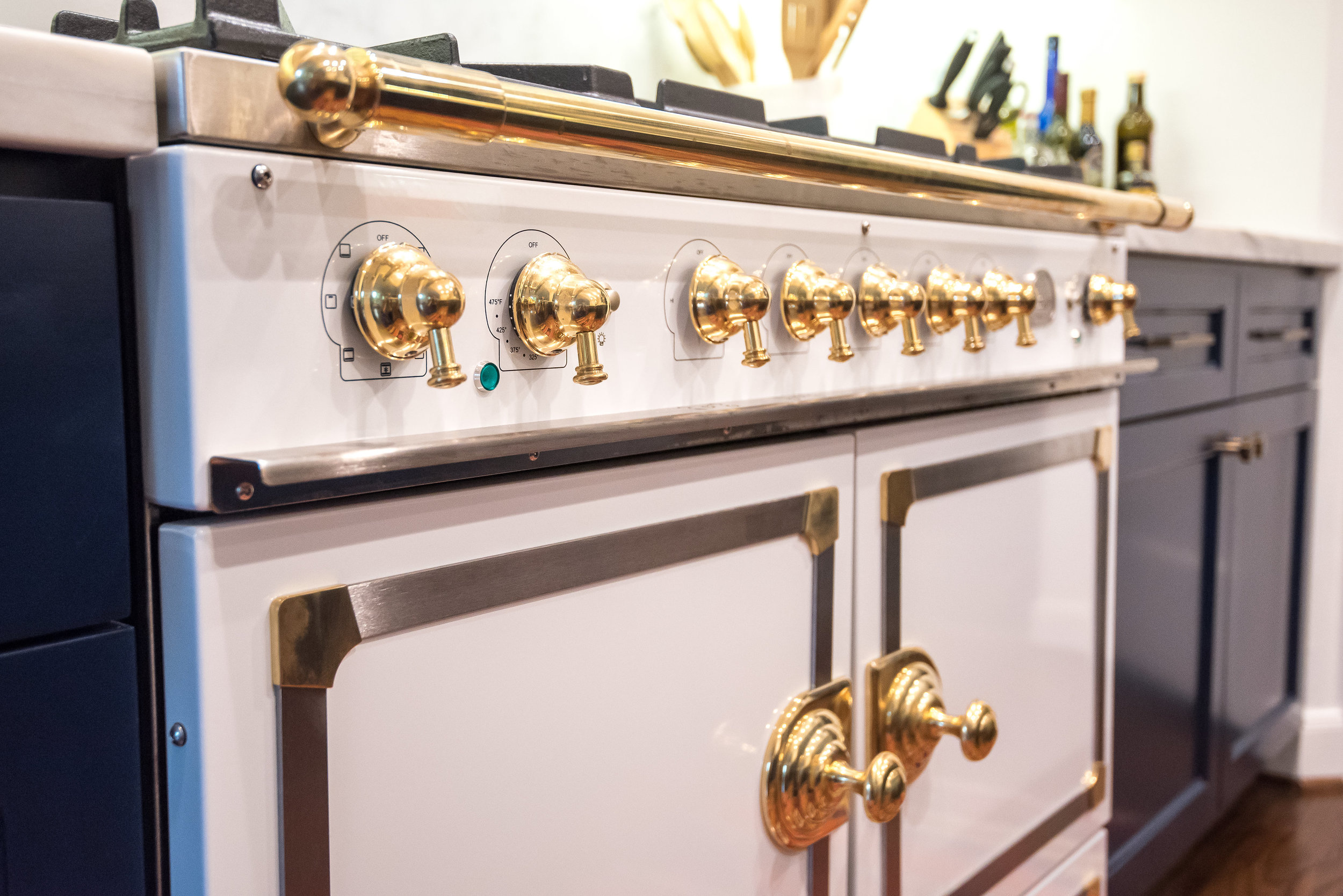 Navy and white kitchen remodel with La Cornue range - Designer Carla Aston