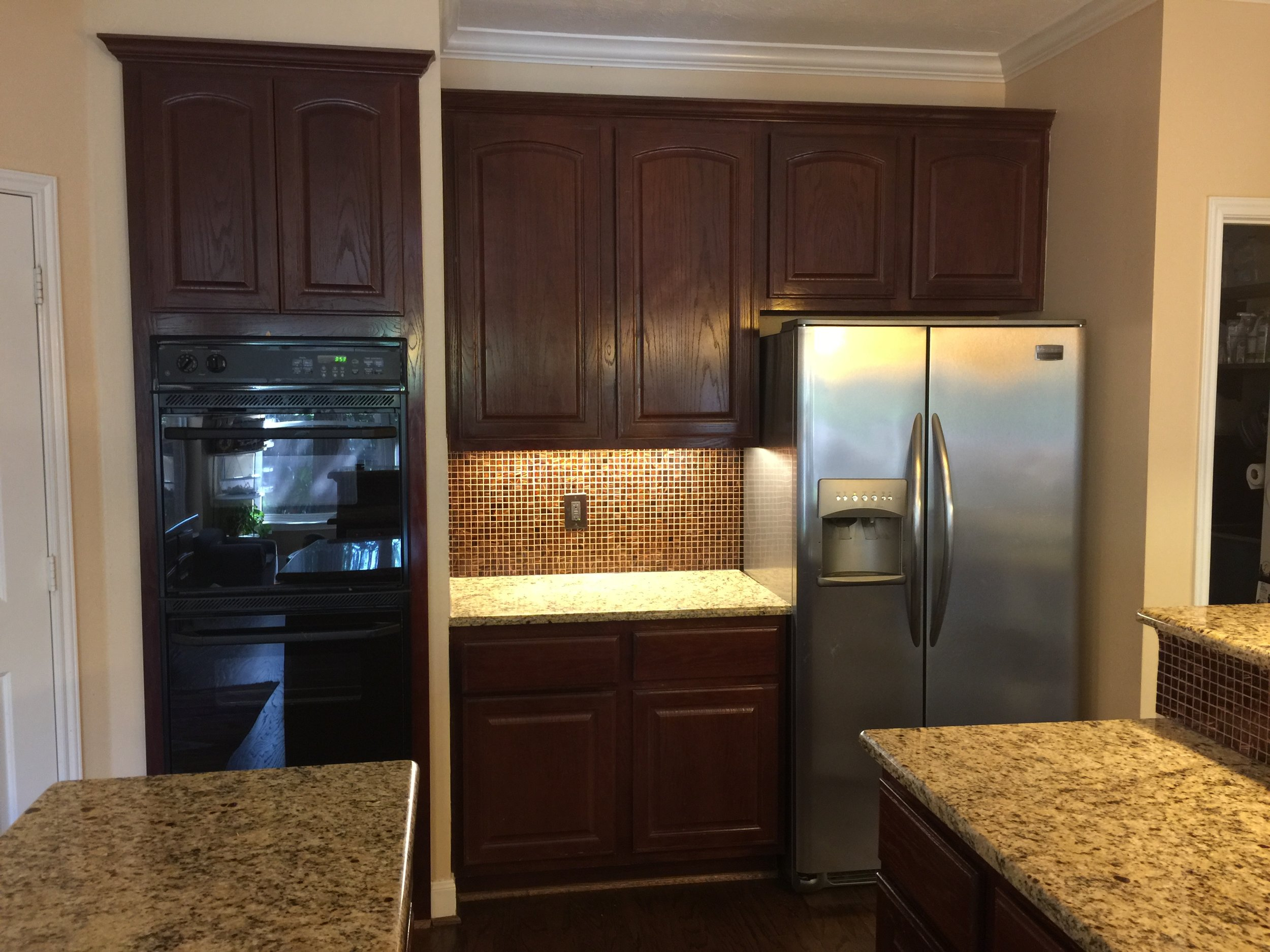 BEFORE - Fridge wall of kitchen remodel with wall ovens