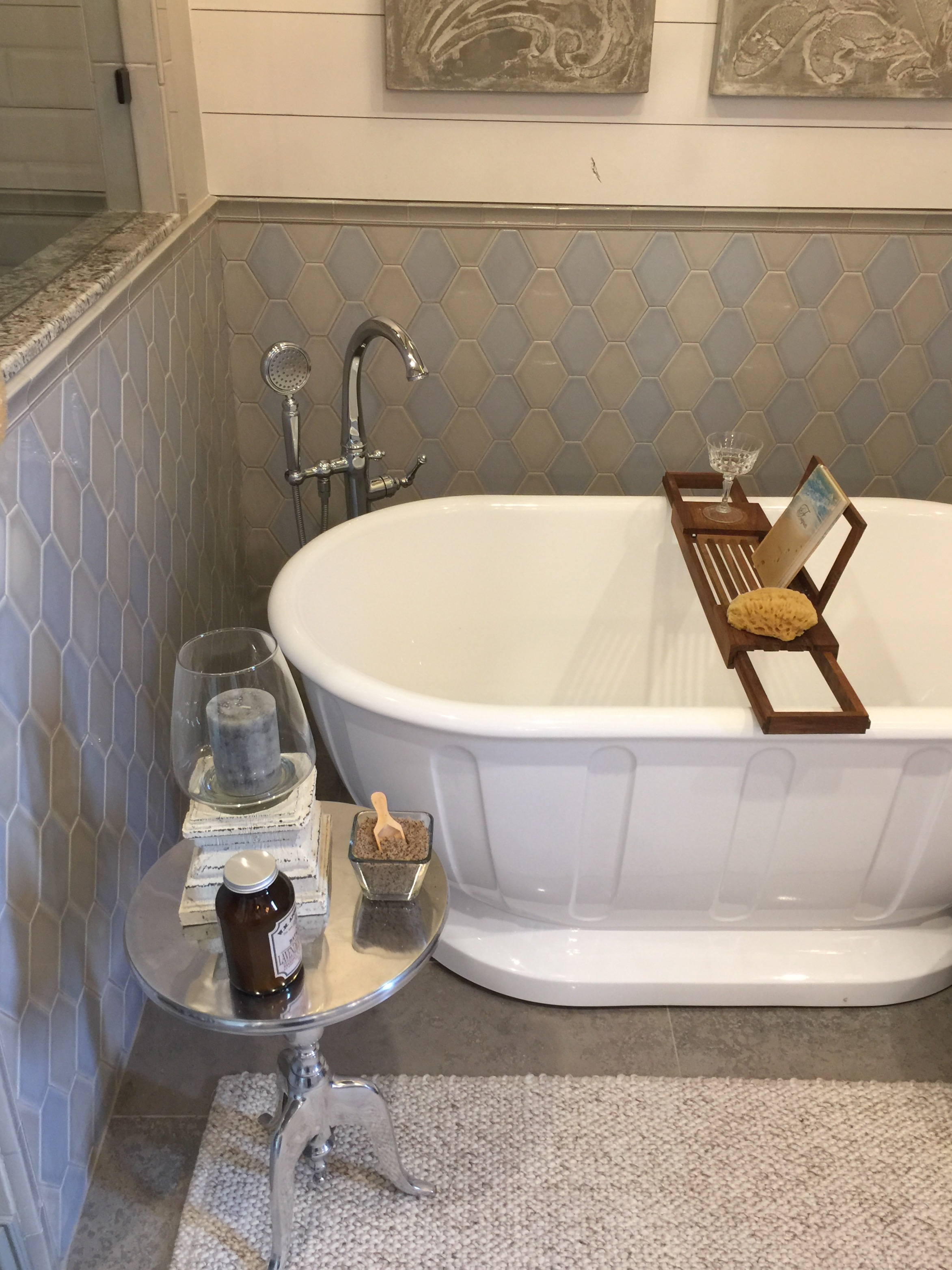 Gray and beige tile mixed in the bathroom with shiplap wall designed by Christina Mullen