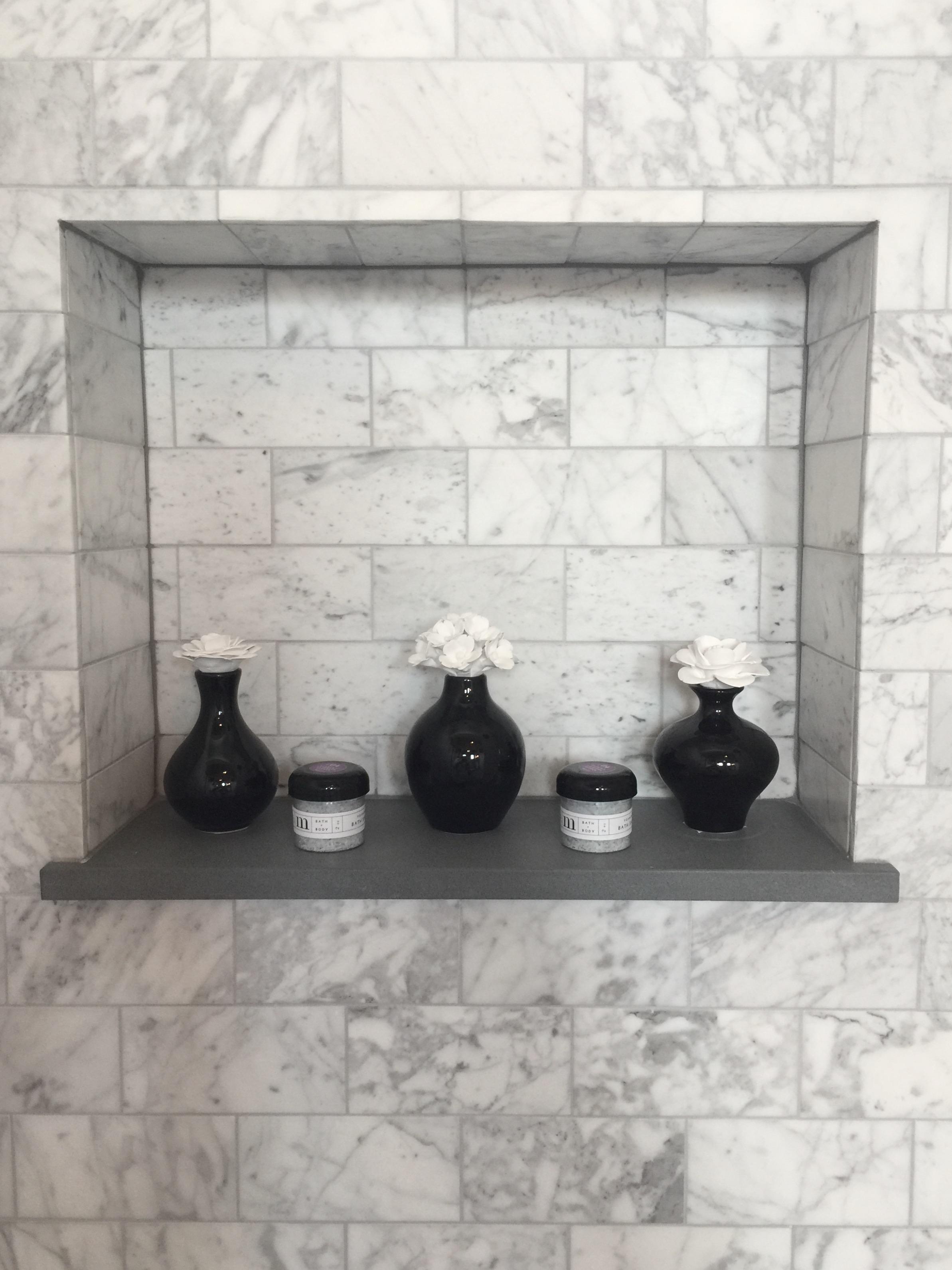 Shampoo niche details in the bathroom designed by Desiree Engram