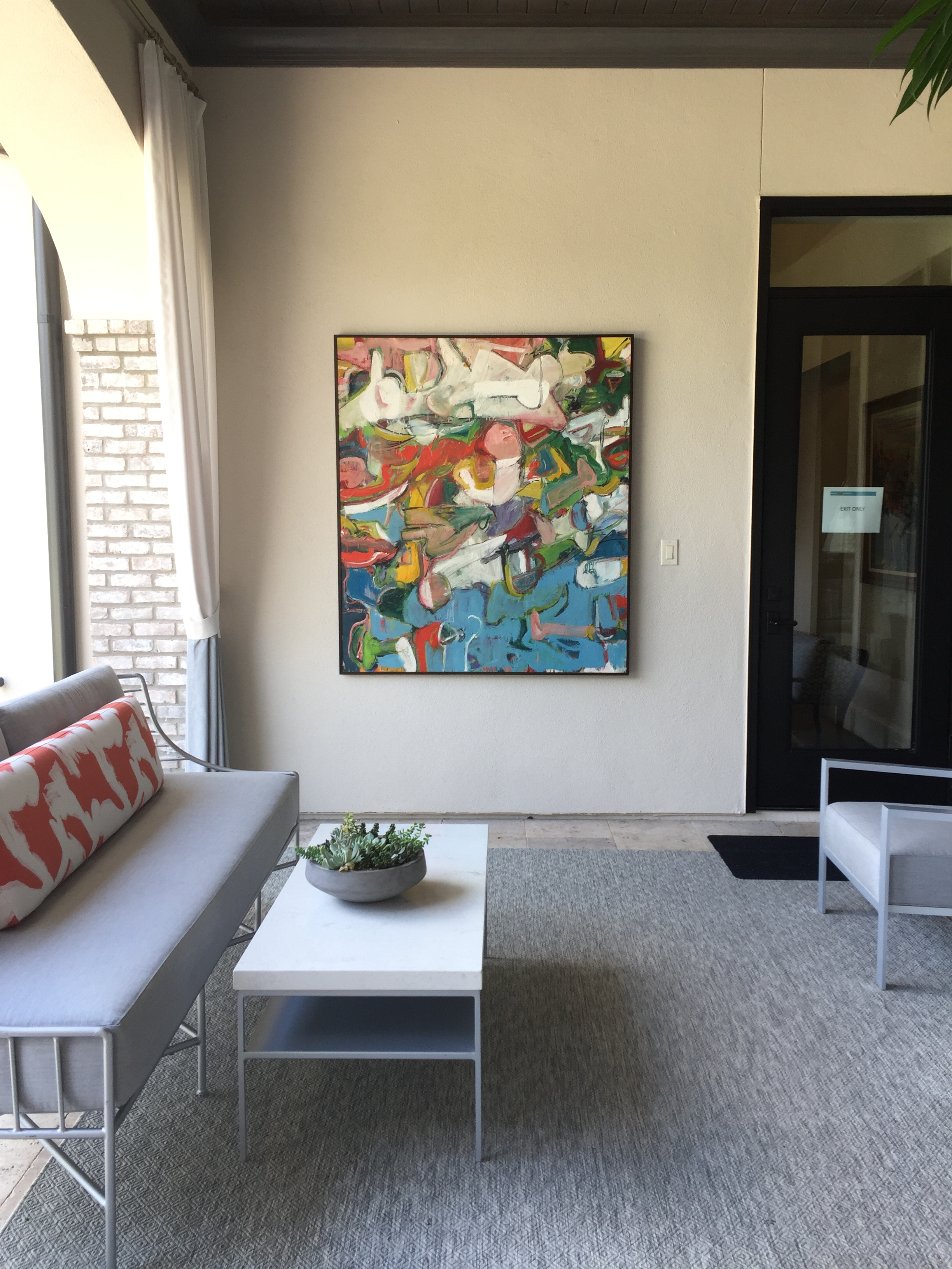 Master suite outdoor patio with art designed by Amilee Wendt