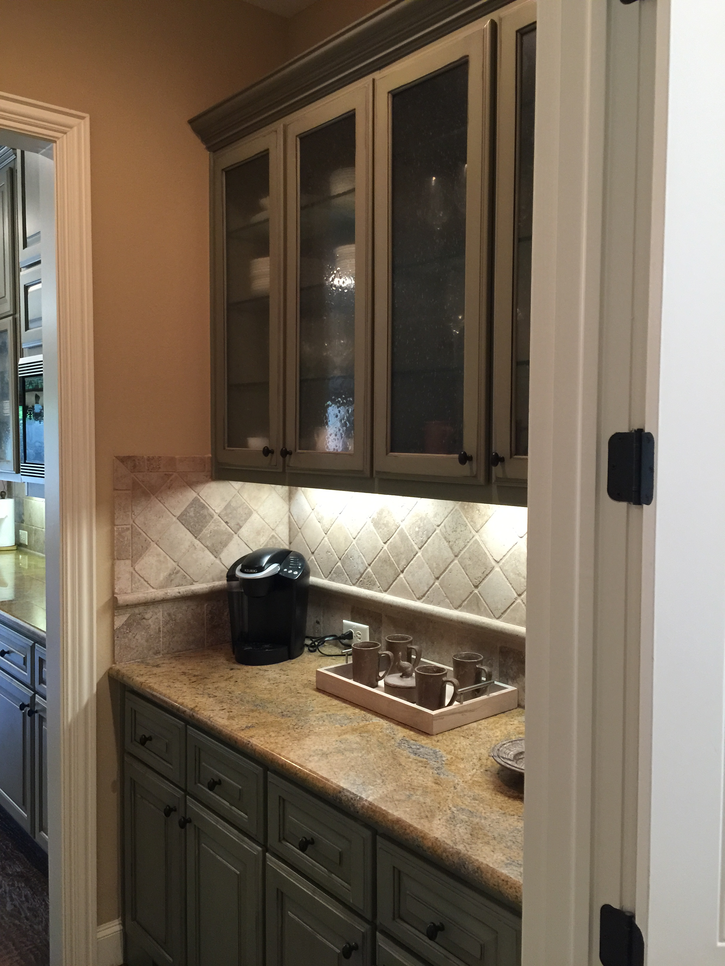 Before Butler's pantry with gold granite, travertine backsplash and sage green cabinets