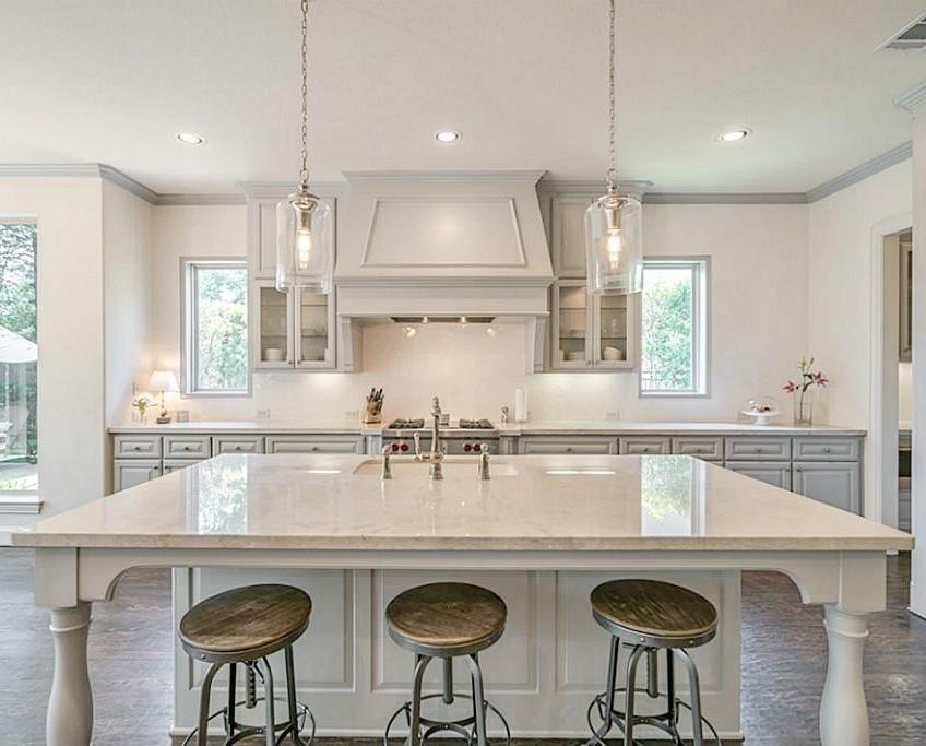 After kitchen remodel with Taj Mahal quartzite, herringbone backsplash, and gray cabinets | Carla Aston Designer