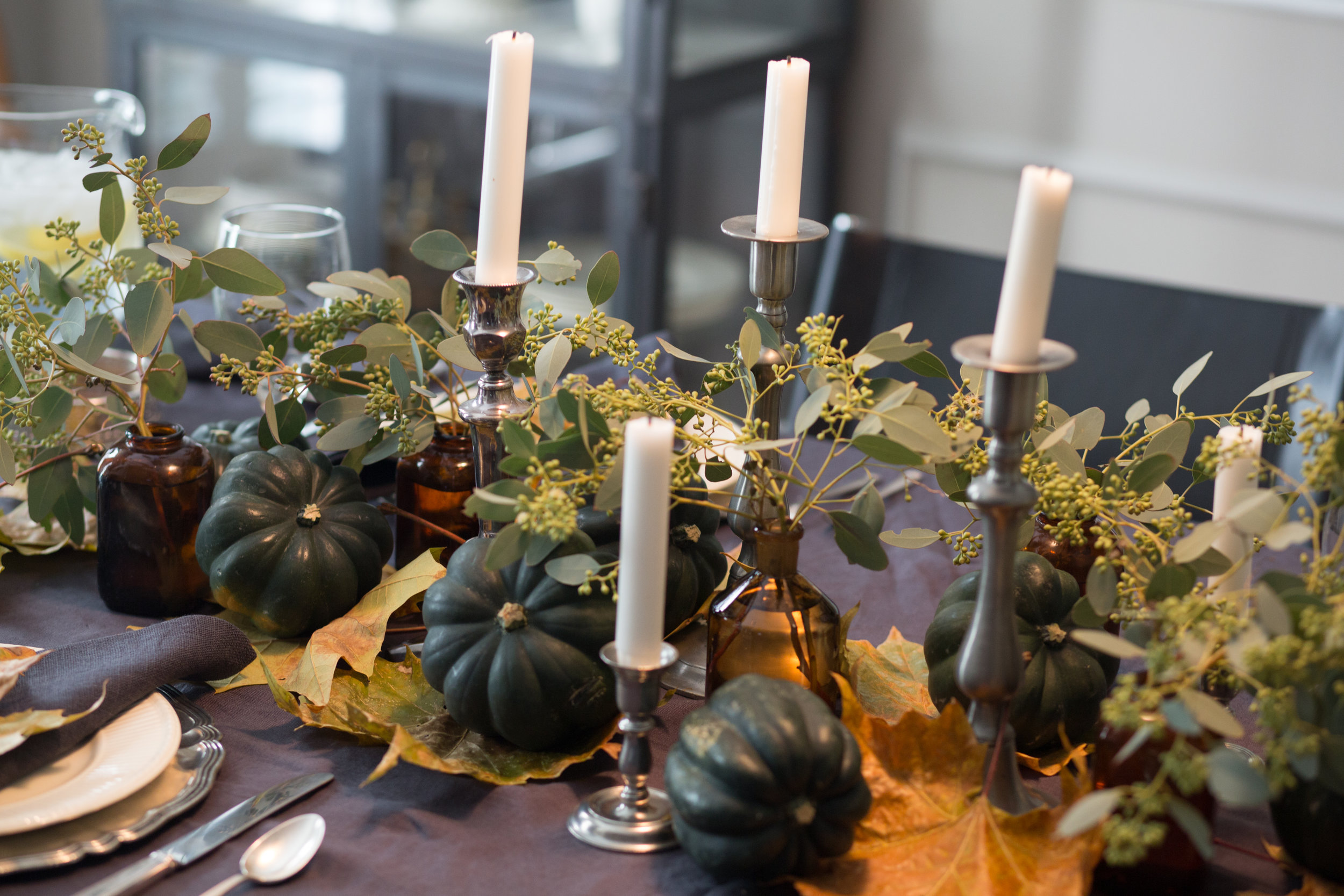 Fall tabletop with greenery and fall leaves