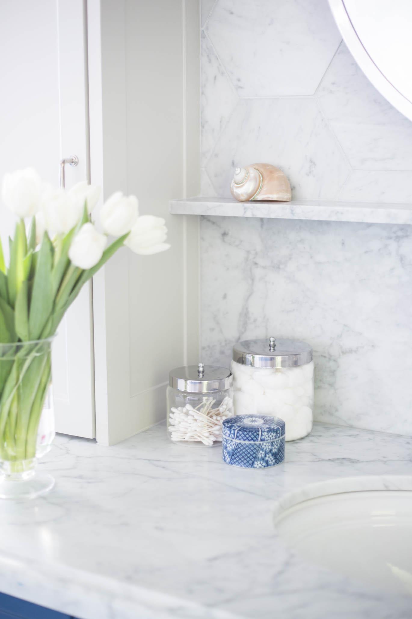 Marble ledge at bathroom sink   Carla Aston, Designer   Tori Aston, Photographer #bathroomremodel #marblebathroom #hextile