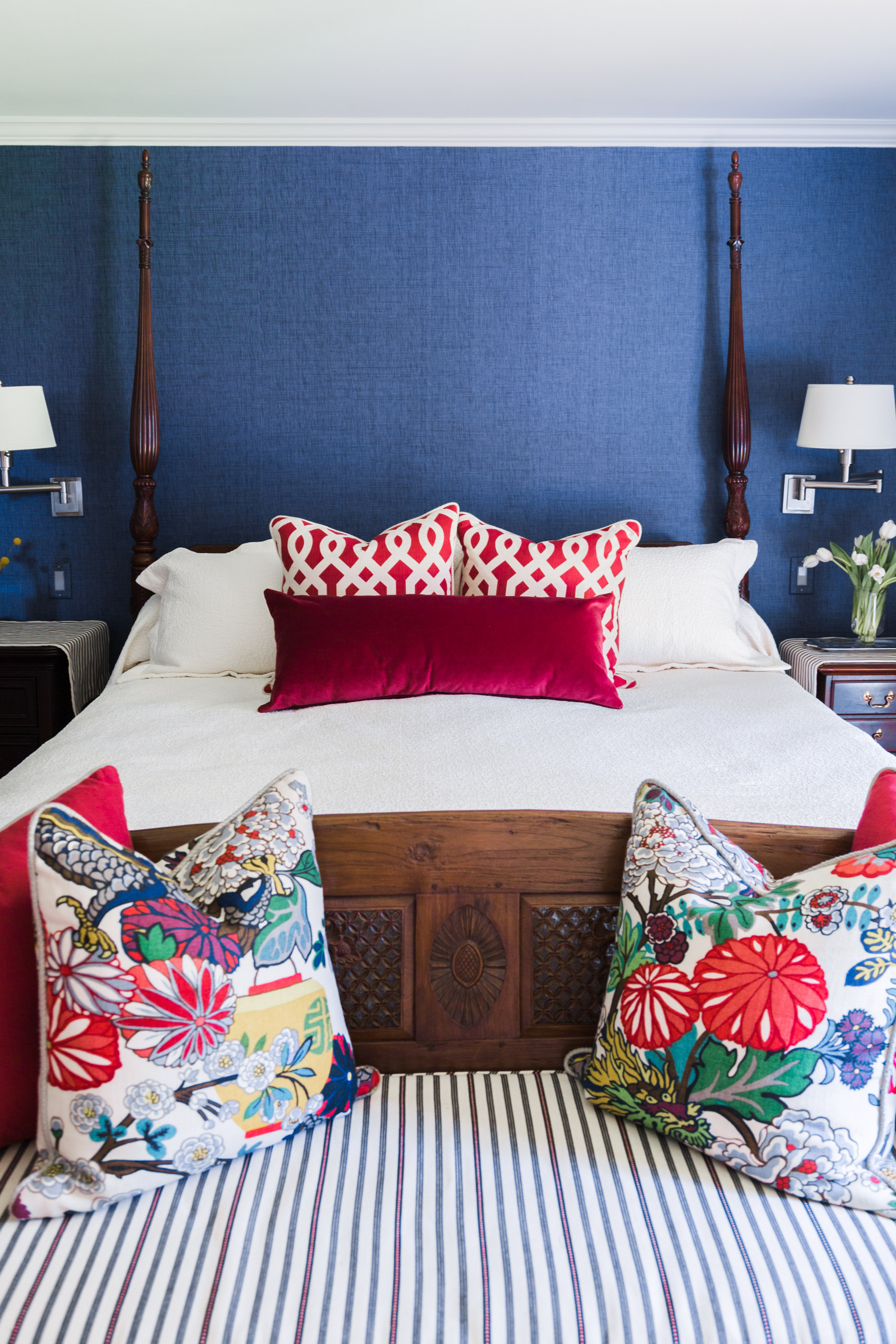 Master bedroom with navy grasscloth and Chiang Mai Dragon fabric pillows  four poster bed   Designer-Carla Aston, Photographer- Tori Aston #grasscloth #fourposterbed