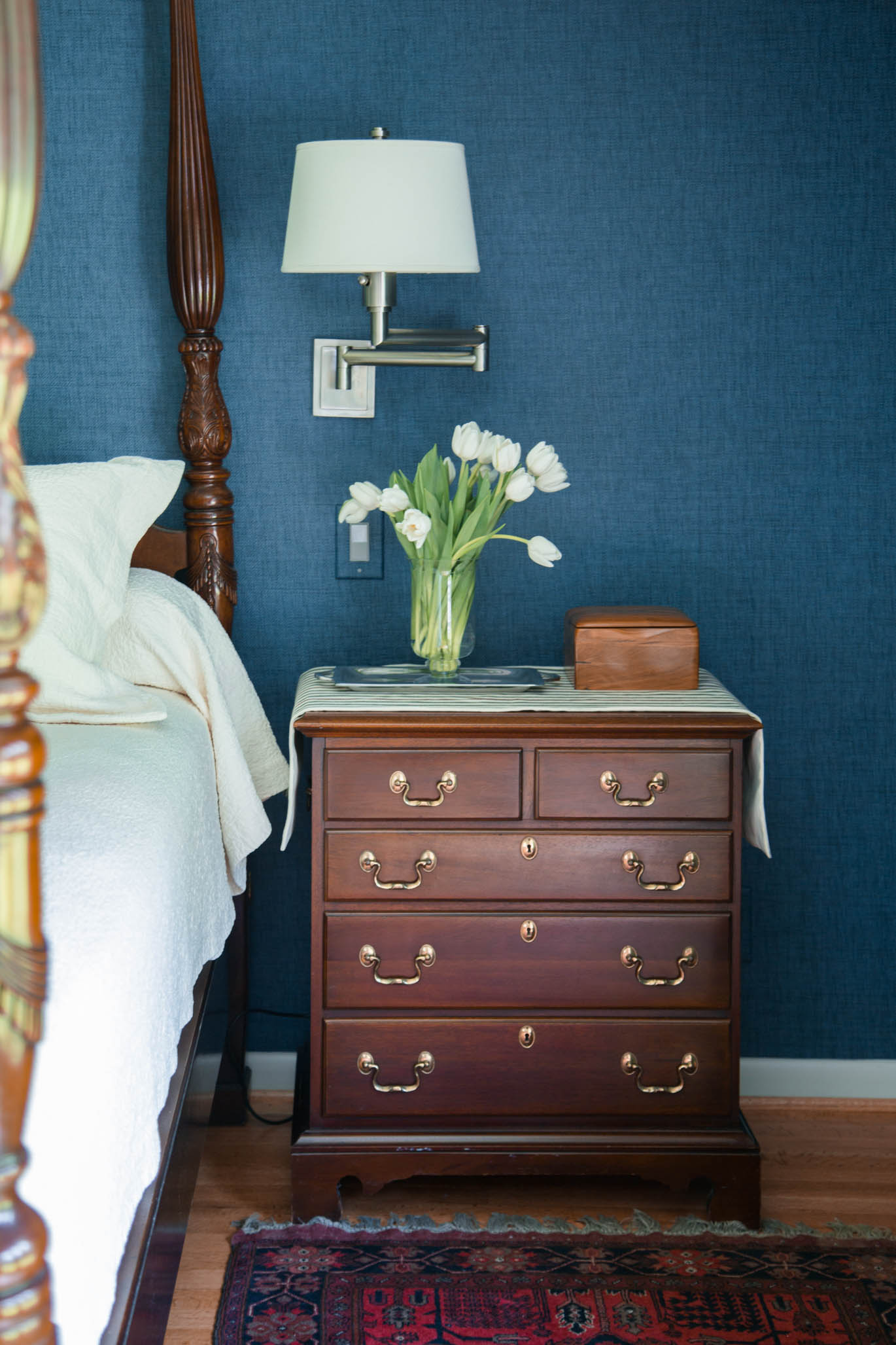 Bedroom with navy grasscloth w cream matelasse bedding and wall mount swing arm lamps over nightstand  Designer-Carla Aston, Photographer- Tori Aston #grasscloth #fourposterbed