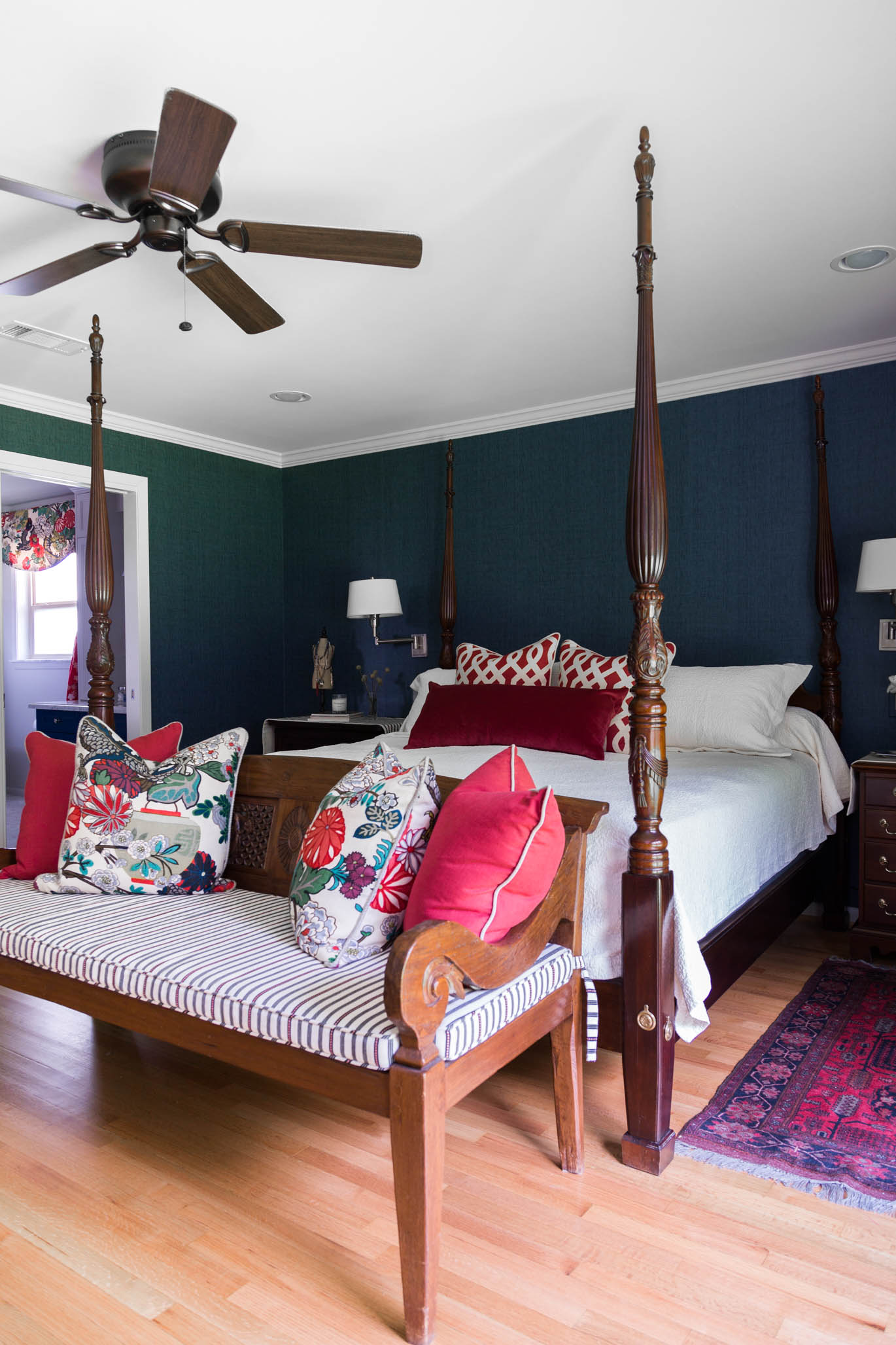 Bedroom makeover with navy grasscloth and colorful pillows with Chiang Mai Dragon fabric   Designer-Carla Aston, Photographer- Tori Aston #grasscloth #fourposterbed