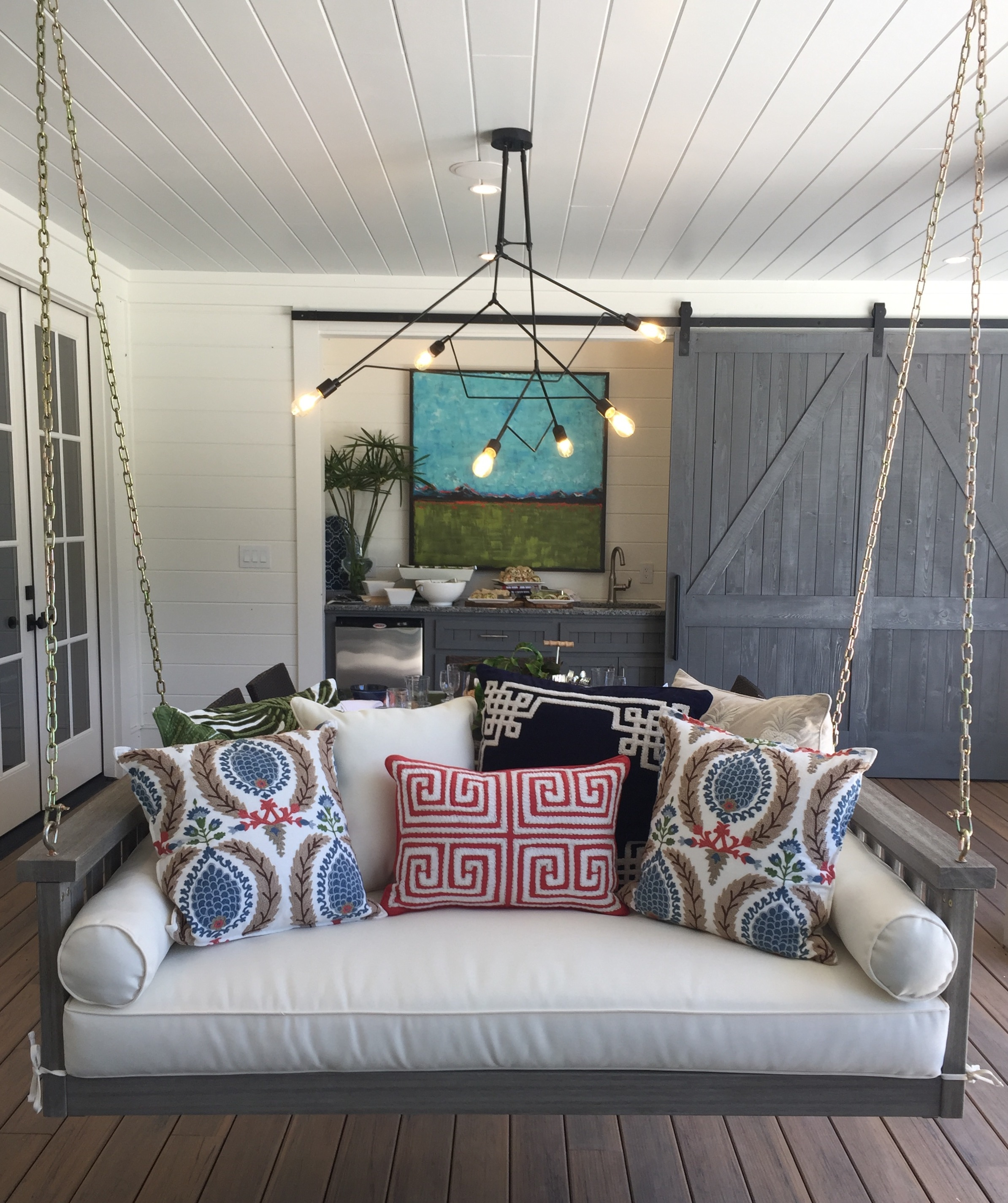 Back porch for outdoor living in the Southern Living Showcase Home, Designed by Chairma Design Group