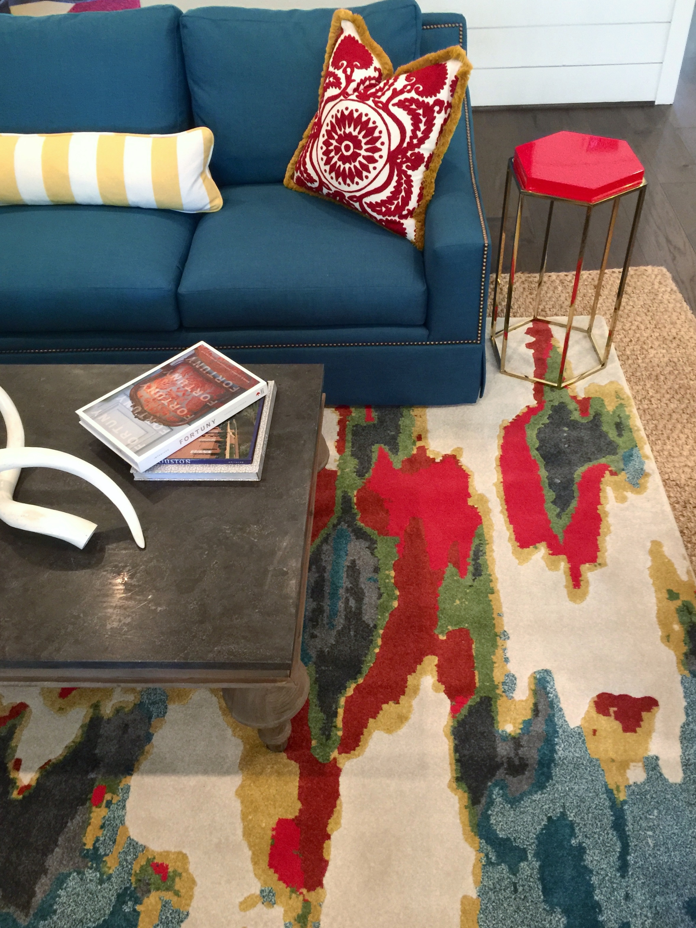 Southern Living Showcase Home - Living Room with colorful rug and furniture, Designed by Chairma Design Group #rug