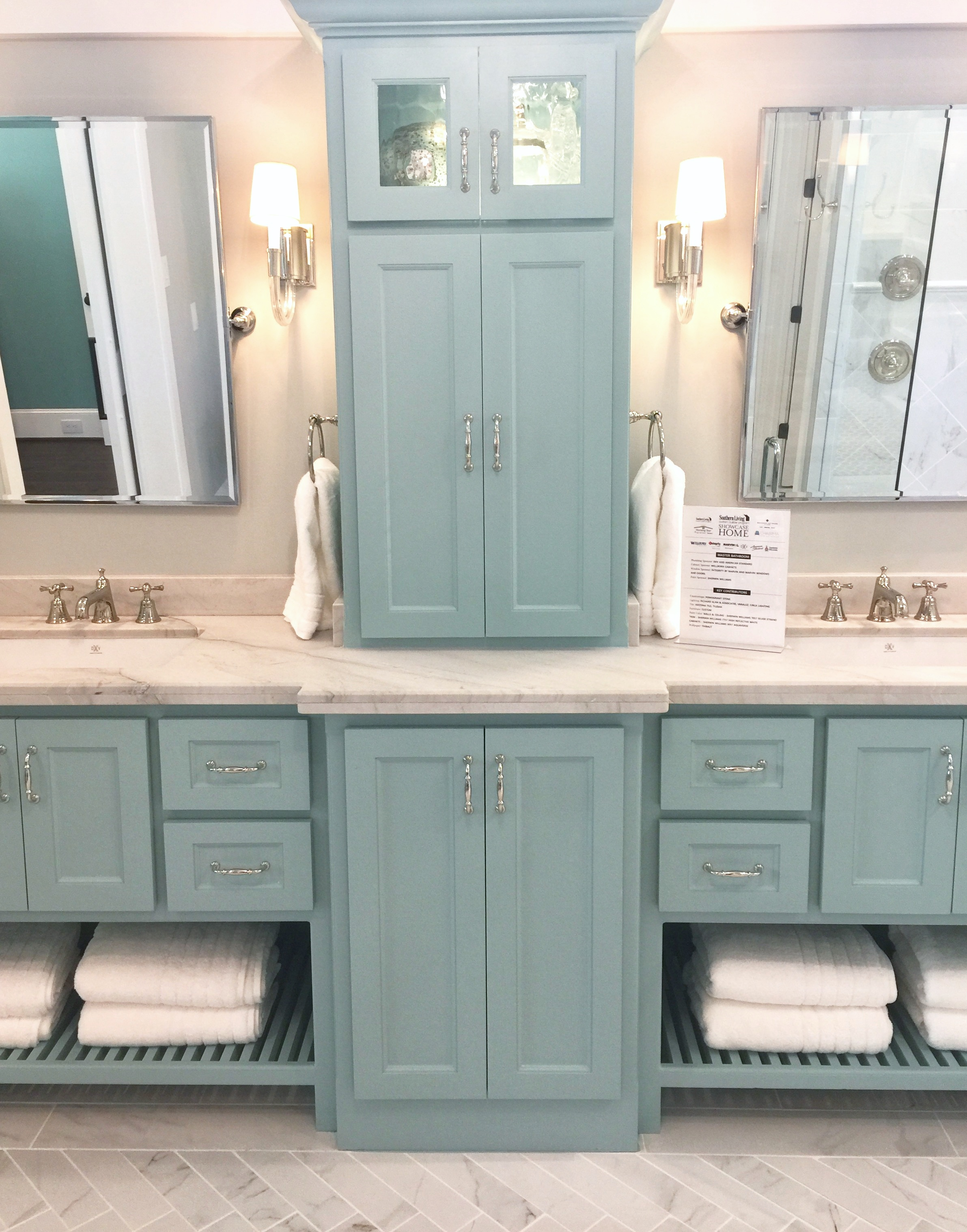 Southern Living Showcase Home - master bath with Tiffany blue cabinetry, Designed by Chairma Design Group #bathroomcabinets