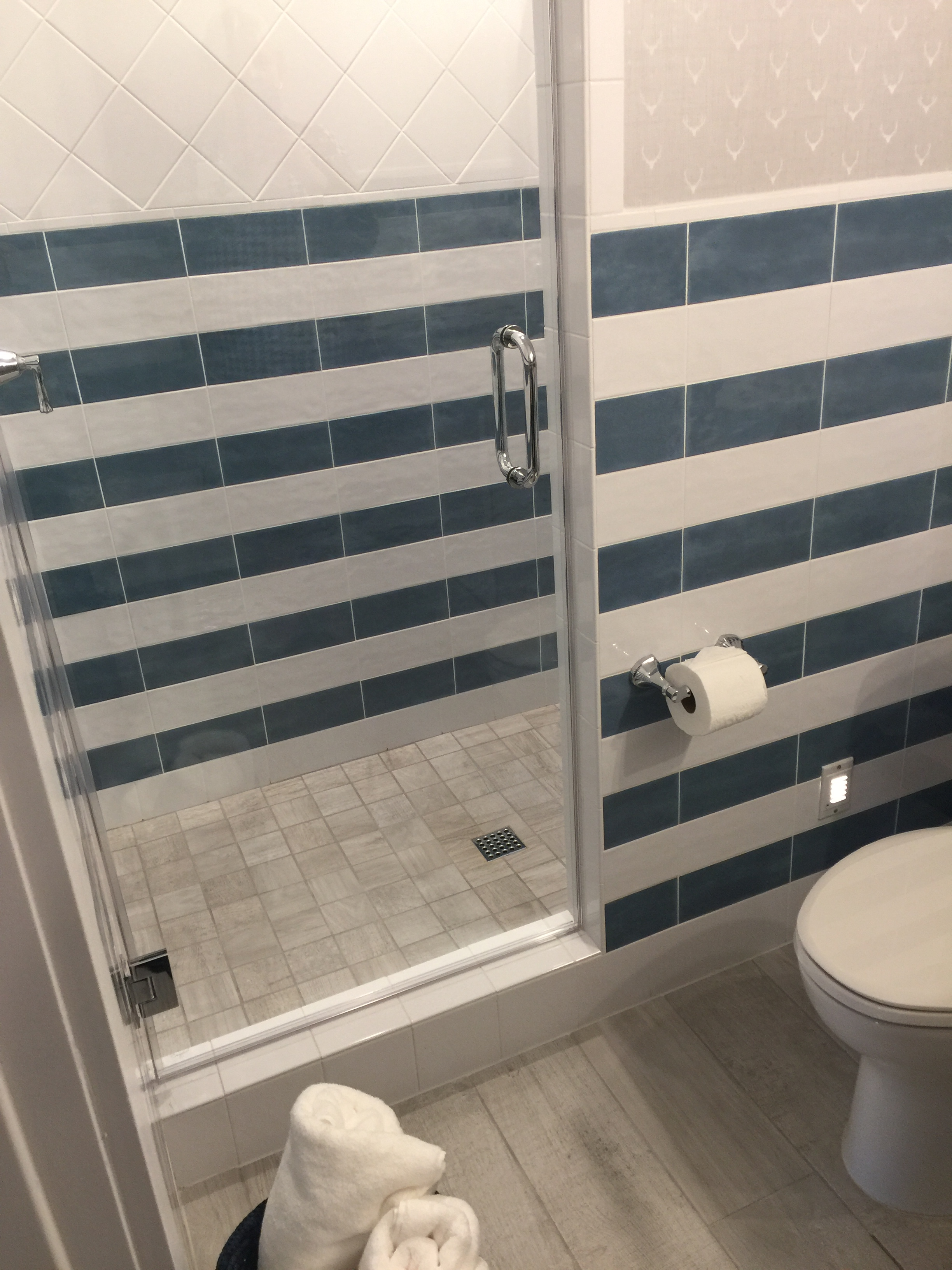 Unique stripe tiled bathroom - Southern Living Showcase Home, Designed by Chairma Design Group