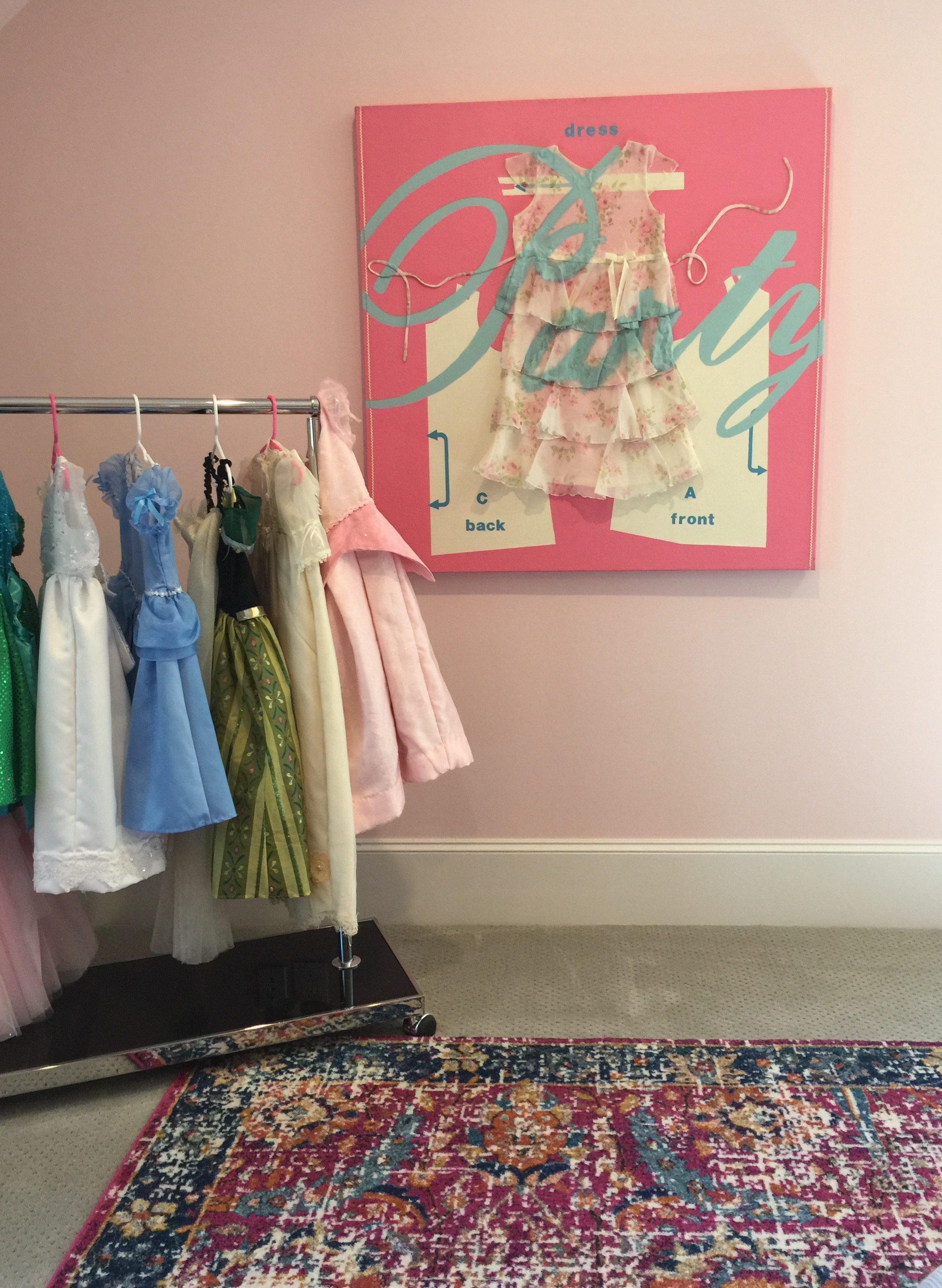 Fun girl's dress up area with custom wall art - Southern Living Showcase Home, Designed by Chairma Design Group