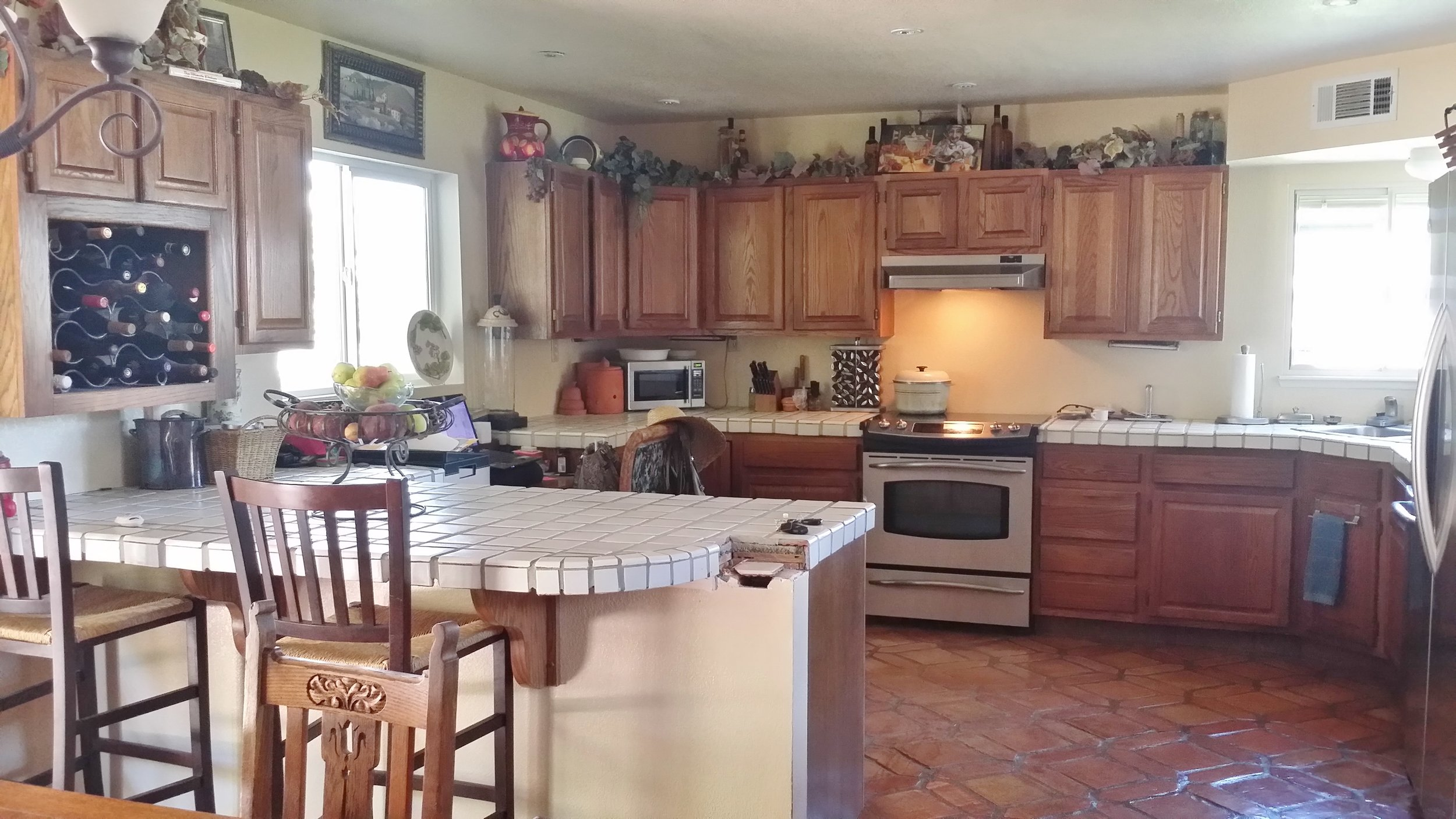 Before the remodel - Kitchen with terracotta floors