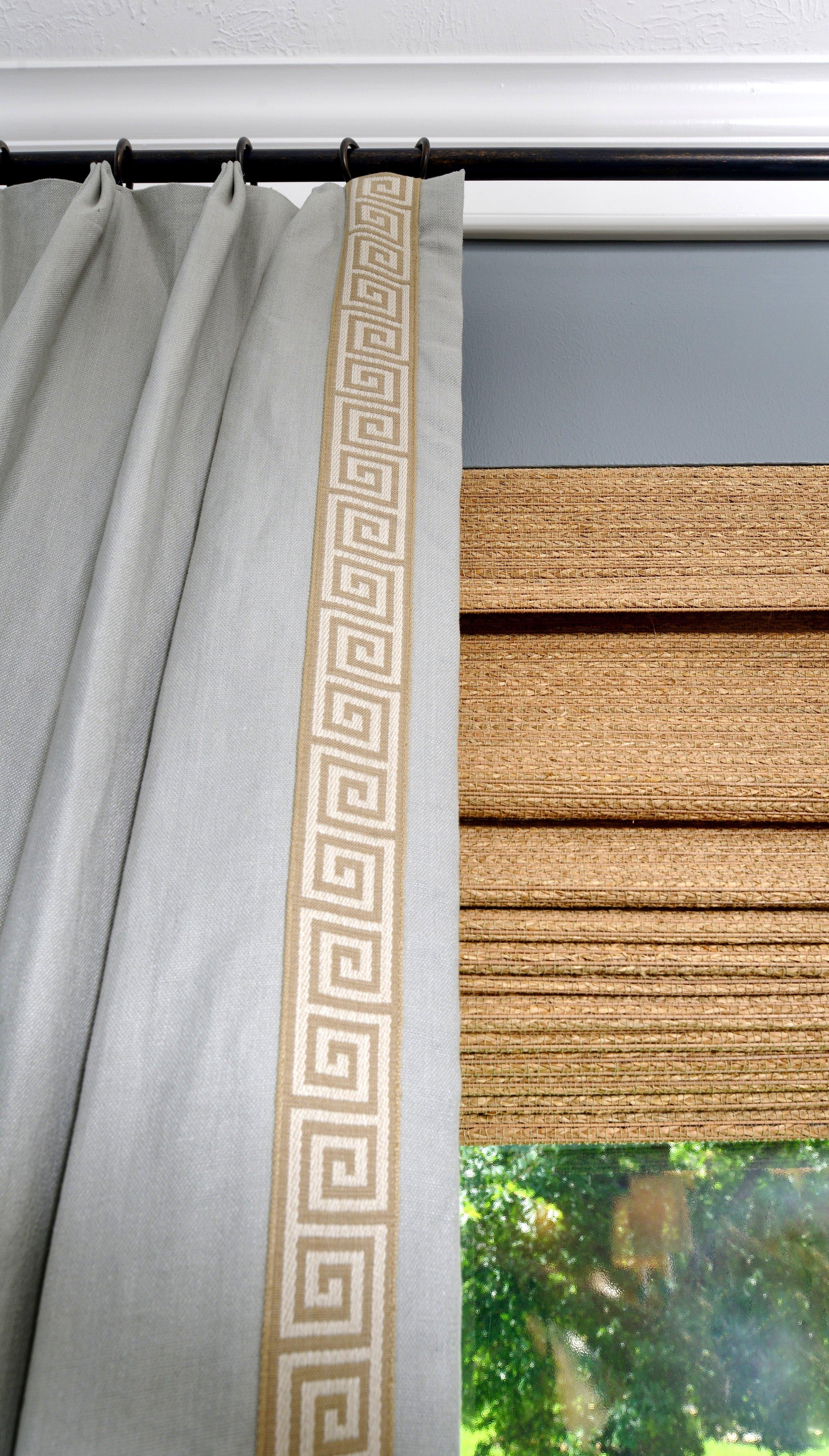 Detail of custom window treatment with greek key tape trim and woven wood shade | Carla Aston, Designer