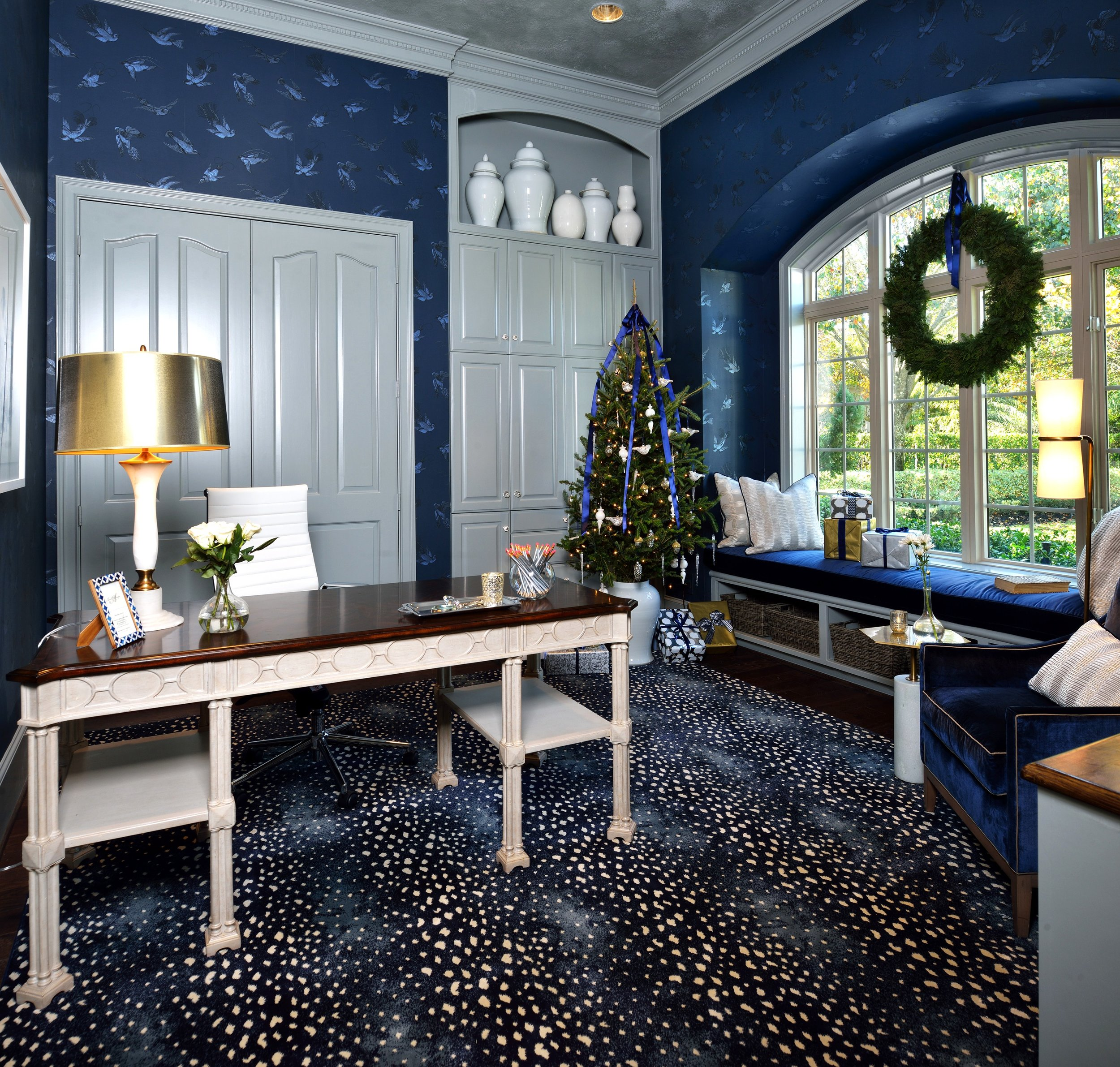 Holiday Showhouse Room, Woman's Home Office - Designer, Carla Aston | Photo by Miro Dvorscak #homeoffice #windowseat #christmasdecor #wreath #christmastree