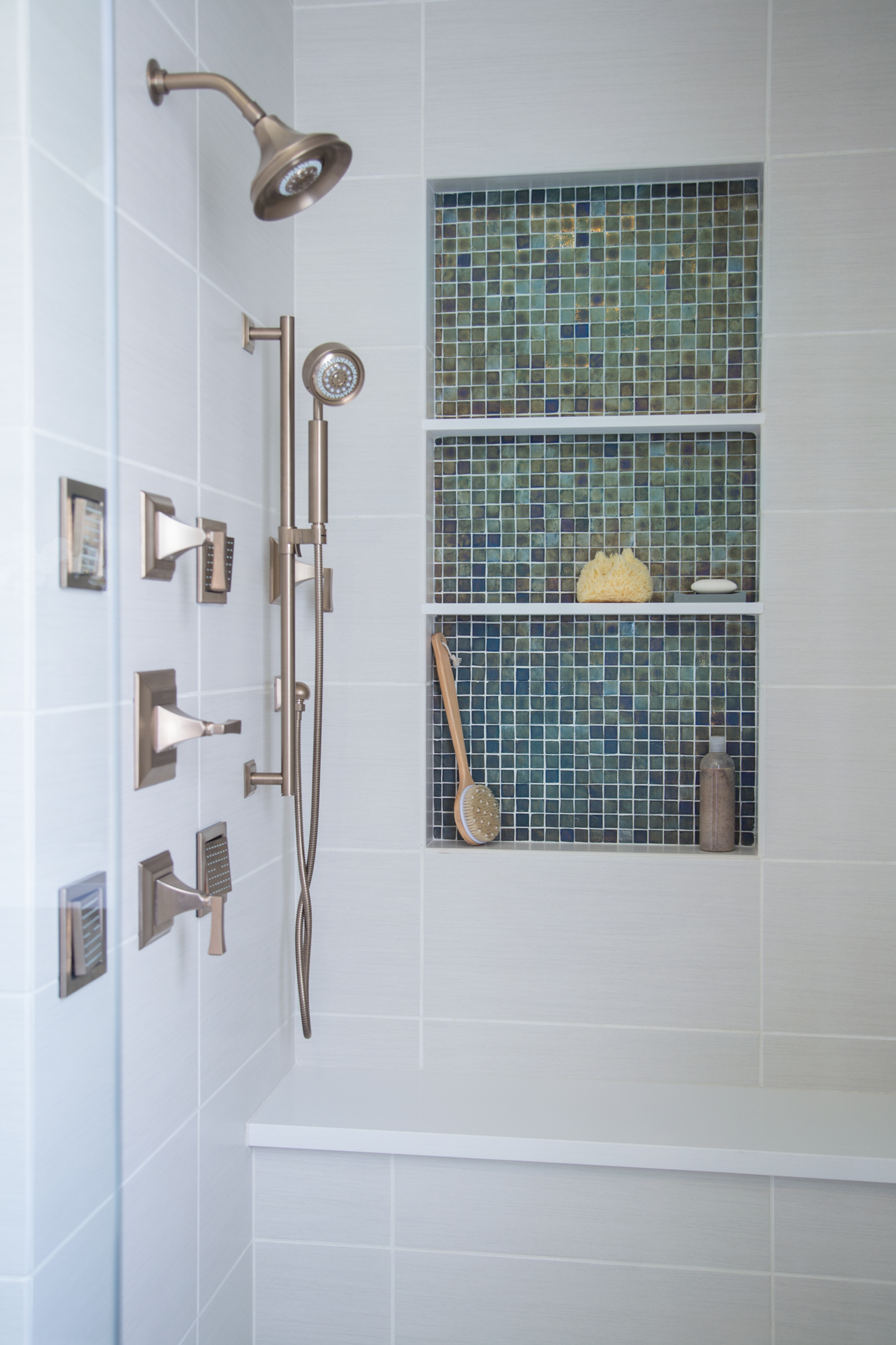 Shower stall with several controls for multiple showering options - Designer: Carla Aston #showerstall #bathroomdesign #shampooniche #showertile