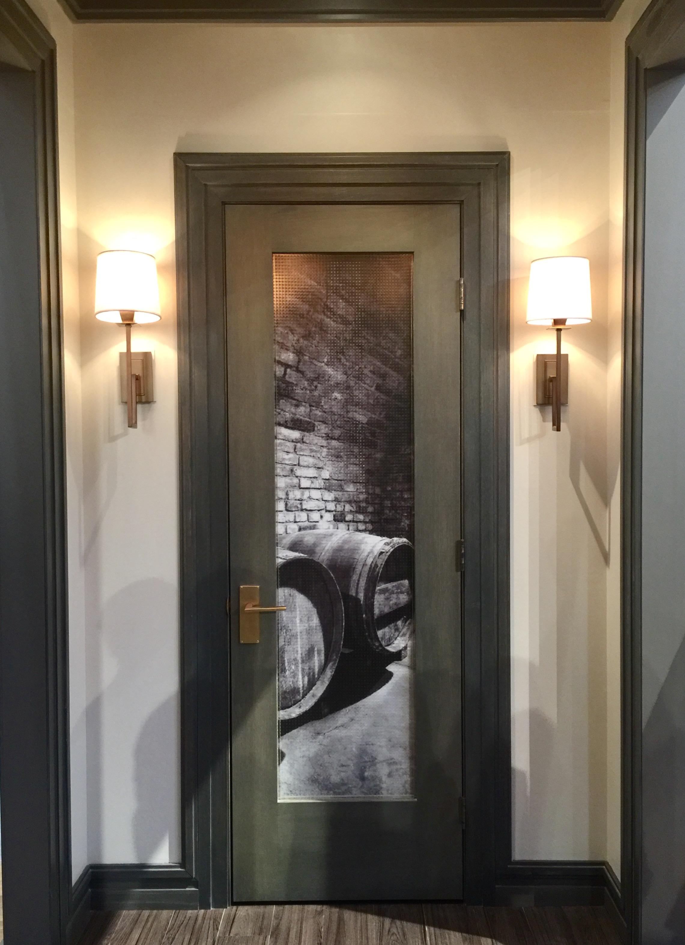 Metrie has a nice selection of beautiful doors. This craftsman style looks great in the wine room. #craftsmanstyle #wineroom #mouldings #interiordesigntips