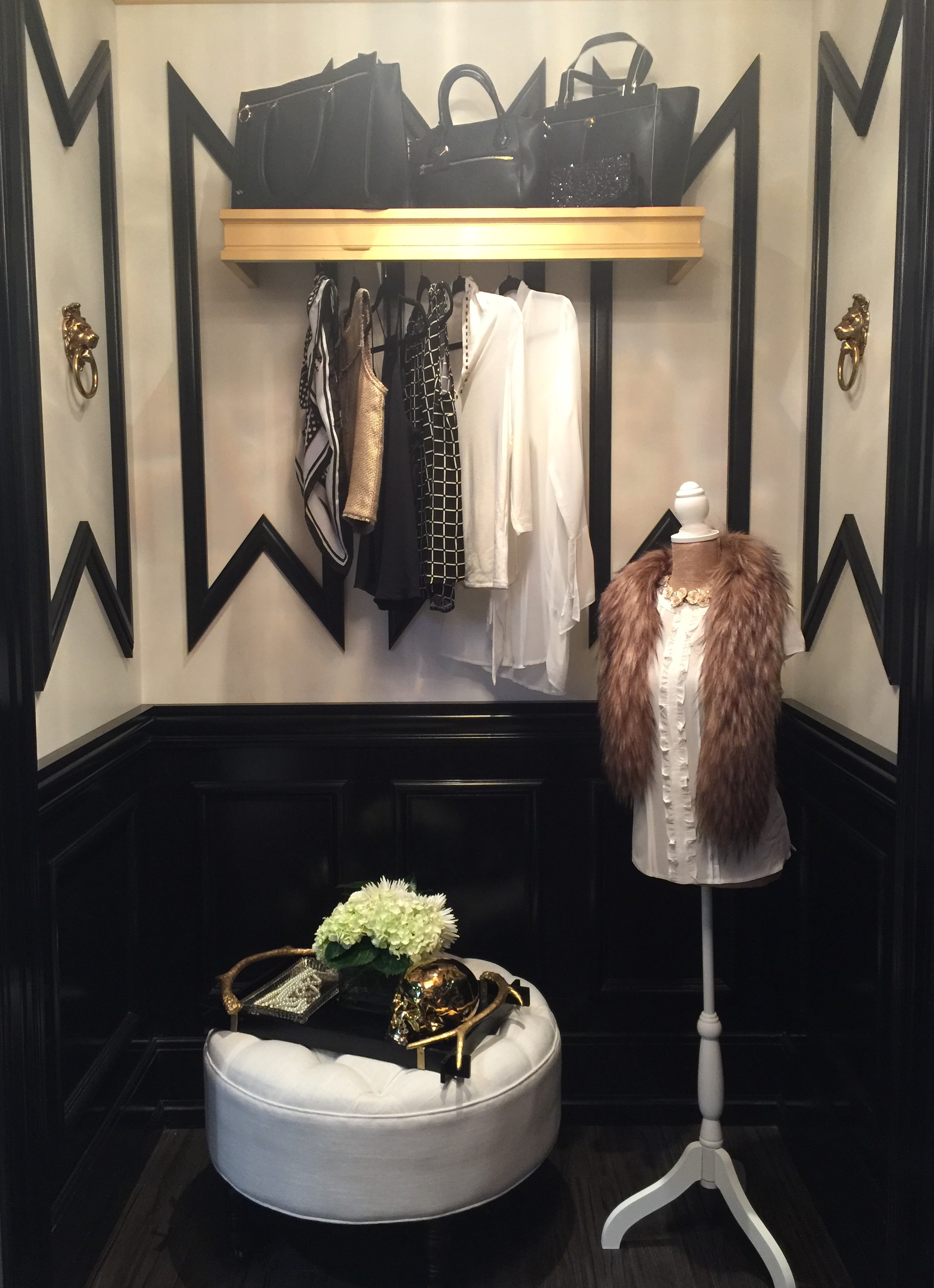 Loving the high contrast of black and cream on the walls here. No need for additional wall decor when your architectural elements do a fine job of adding interest and detail. #mouldings #closet #dressingroom #interiordesigntips
