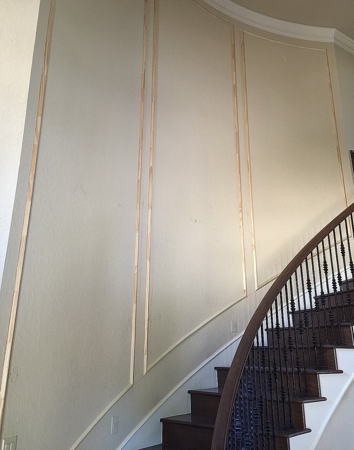 IN PROGRESS - Here we added some mouldings to a grand staircase wall that looked more than a little plain and drab. Carla Aston, Designer