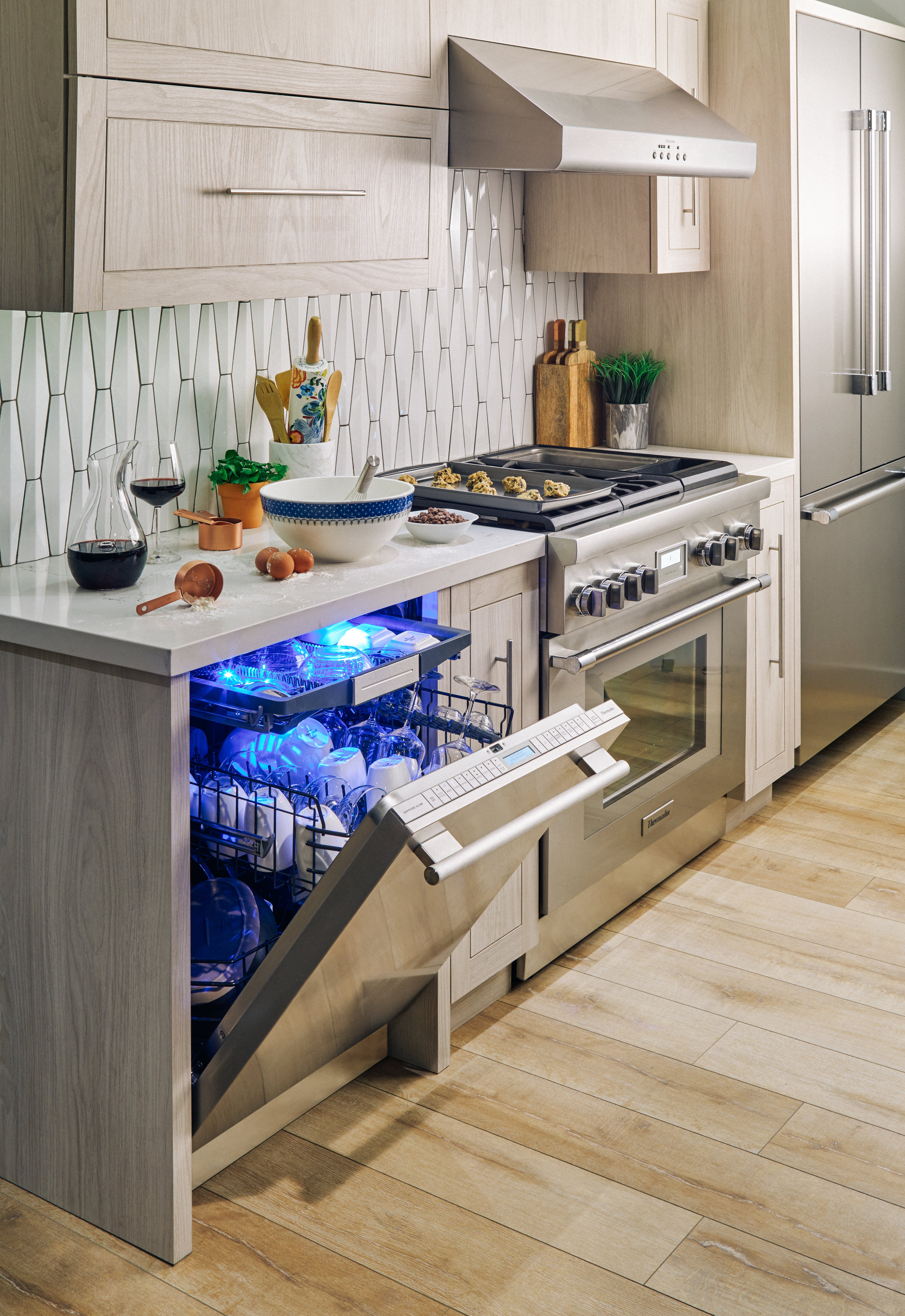 Kitchen with light oak cabinets and Thermador dishwasher #kitchen #thermador