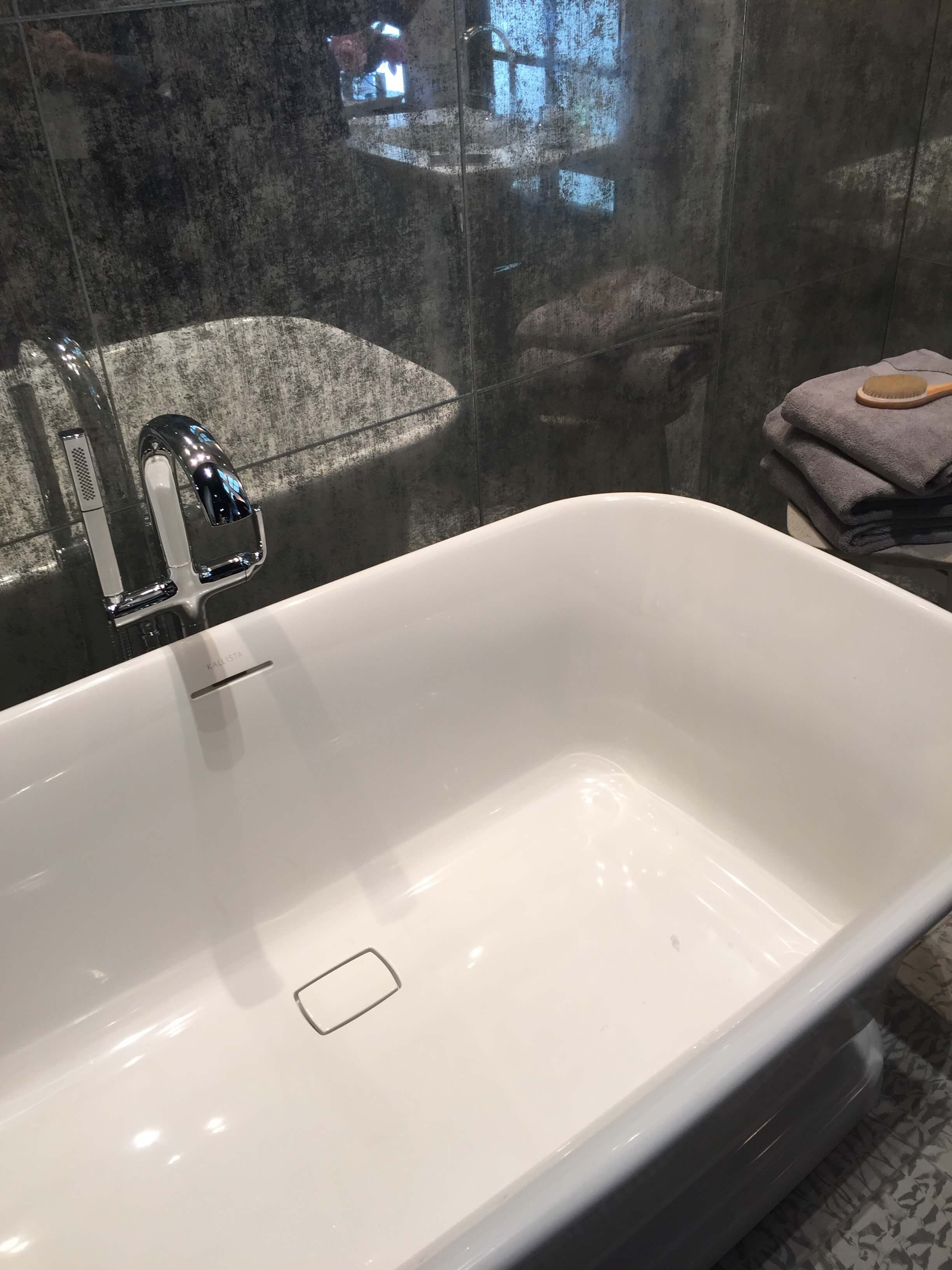Mirrored tiles were big at KBIS, especially in the Ann Sacks booth. Love these antiqued mirror tiles for their more subtle, reflective quality. #bathroom #mirroredtile