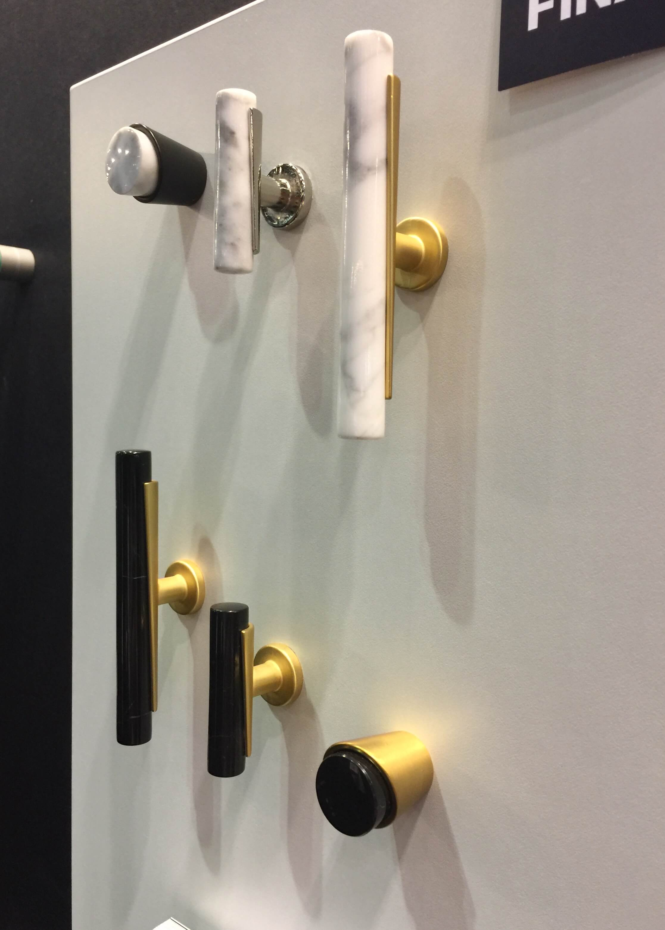 Cabinet pulls from Belwith-Keeler in black, white and brass, with asymmetrical details #cabinetpulls #hardware