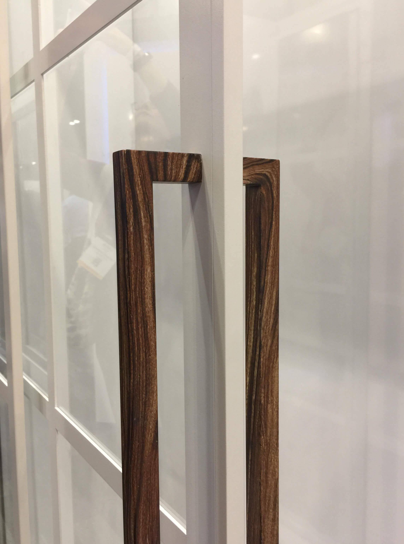 Aluminum shower doors with wood look details by Coastal Shower Doors #showerdoors #showerenclosure