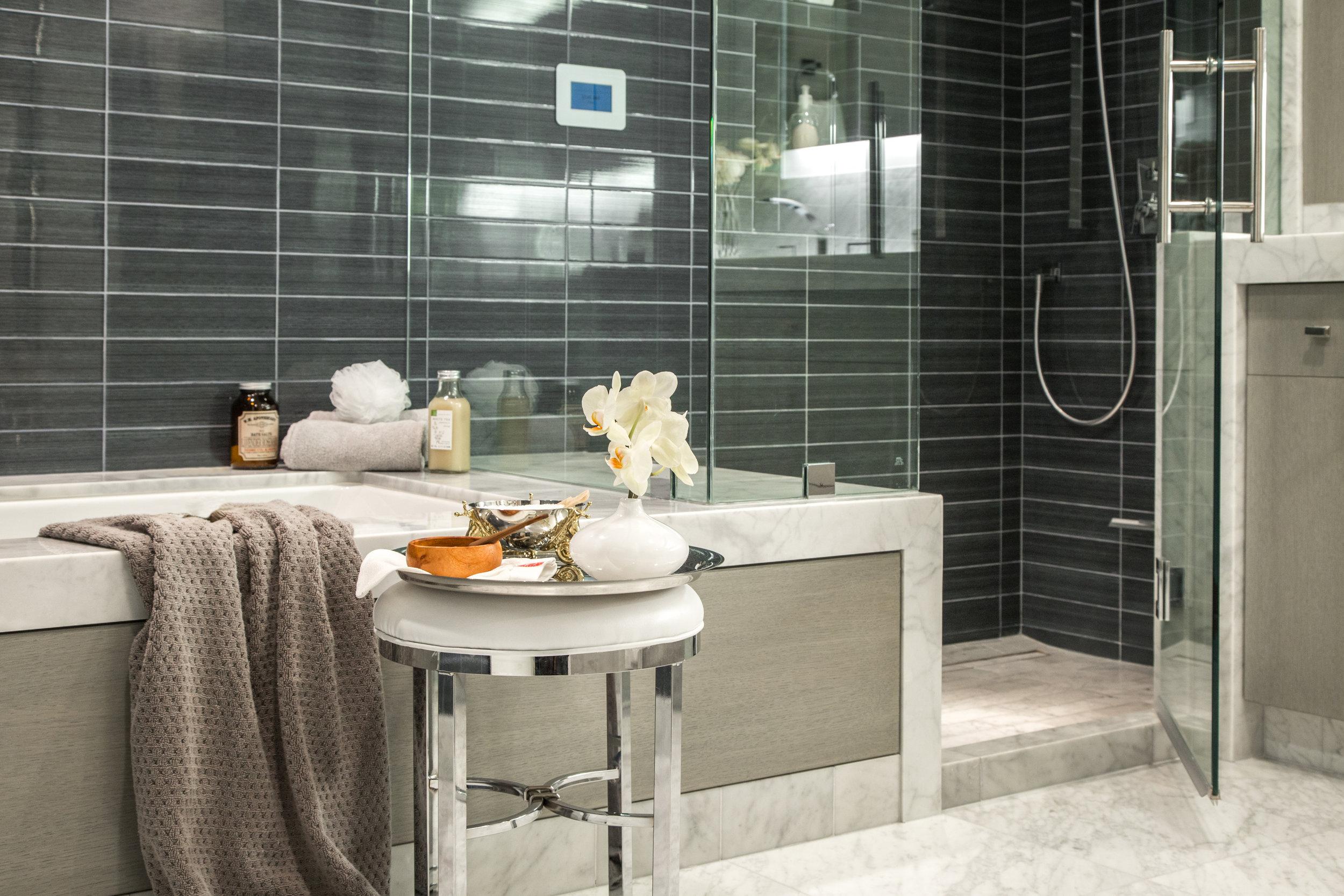 Steam shower designed in luxury bathroom by Designer: Lori Gilder #steamshower #bathroomremodel #blacktile