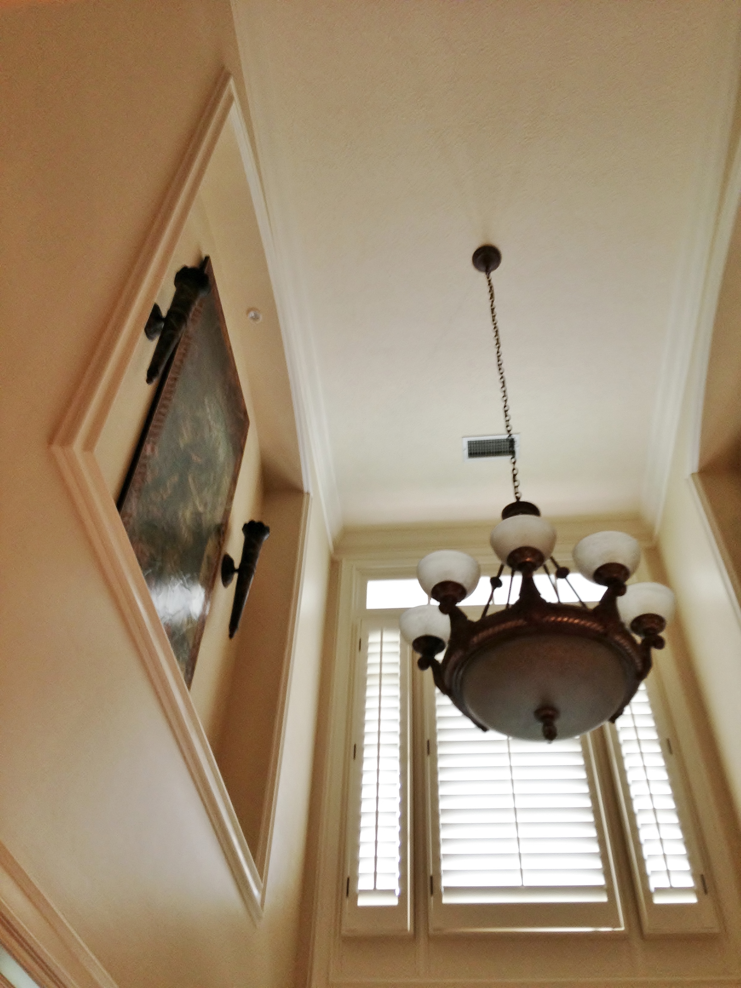 Another high wall niche in an entry hall. Difficult to reach to dust properly. #wallniche
