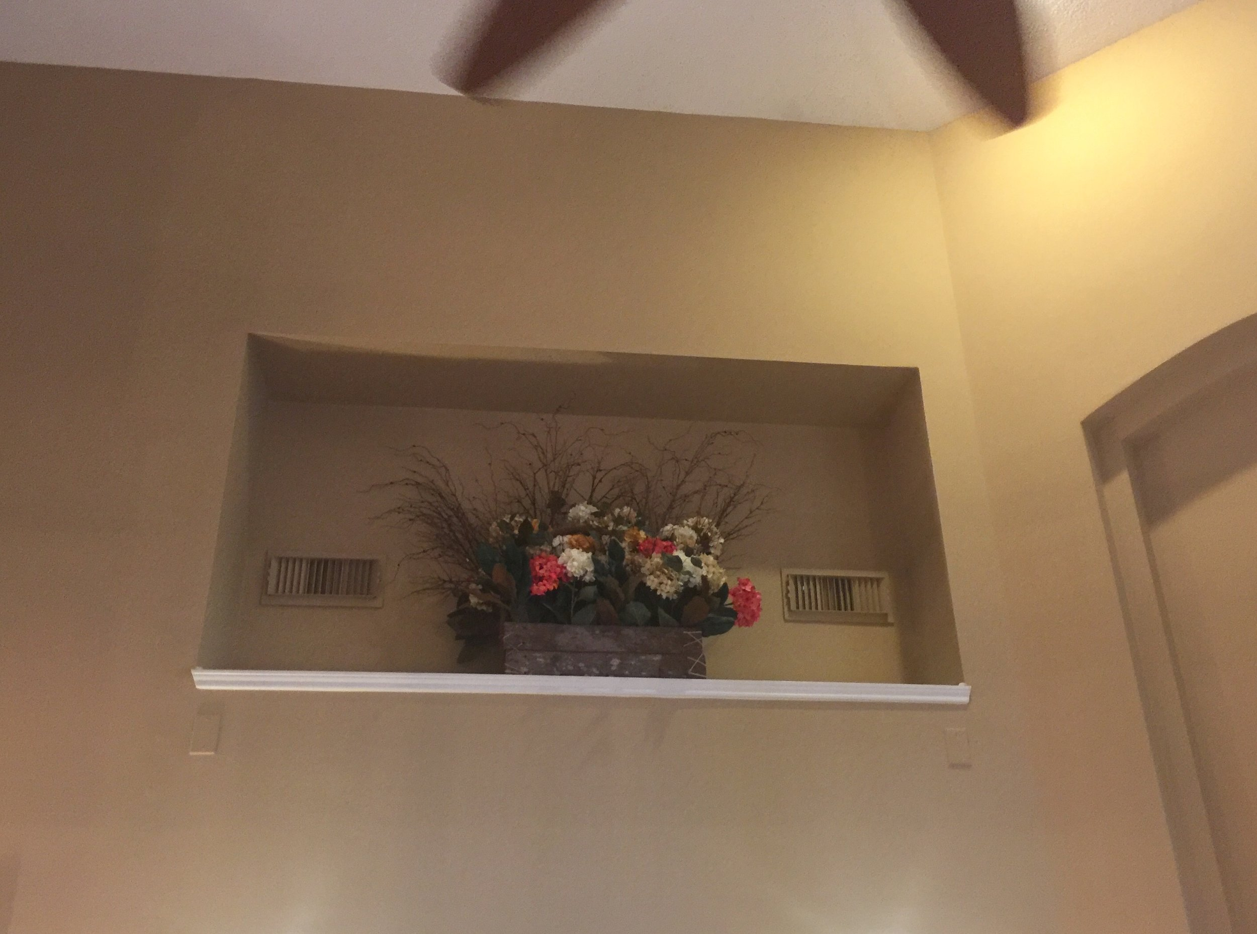 Ah yes, the dusty flower arrangement. Perfect for a niche that is 16' up off the ground. And those A/C vents look really nice featured in the niche, right? :-( #wallniche