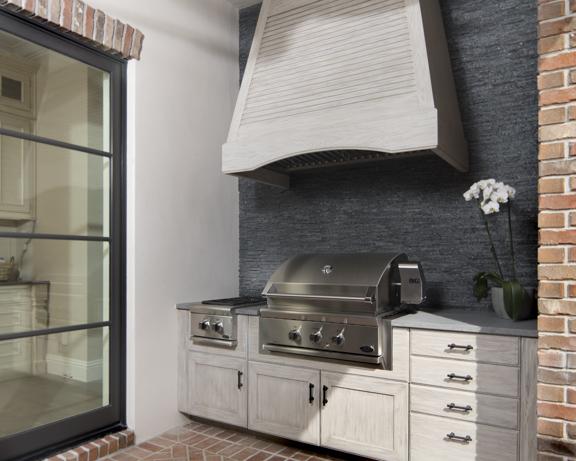 Outdoor kitchen in The New American Remodel - Orlando, KBIS #outdoorkitchen #outdoorliving