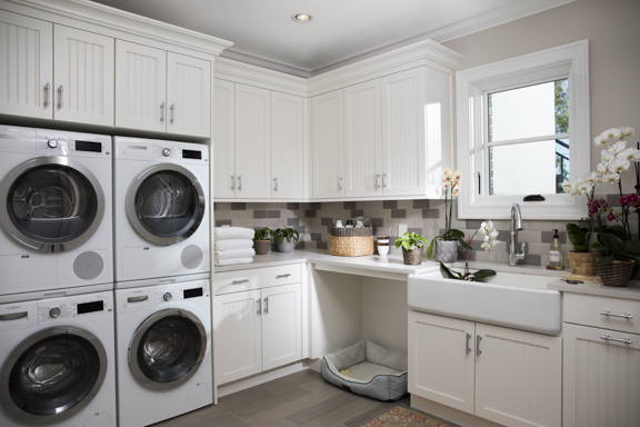 Spacious laundry room in The New American Remodel - Orlando, KBIS2018 #laundryroom #farmsink