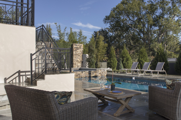 Outdoor patio in The New American Remodel - Orlando, KBIS #pool #patio #outdoorliving