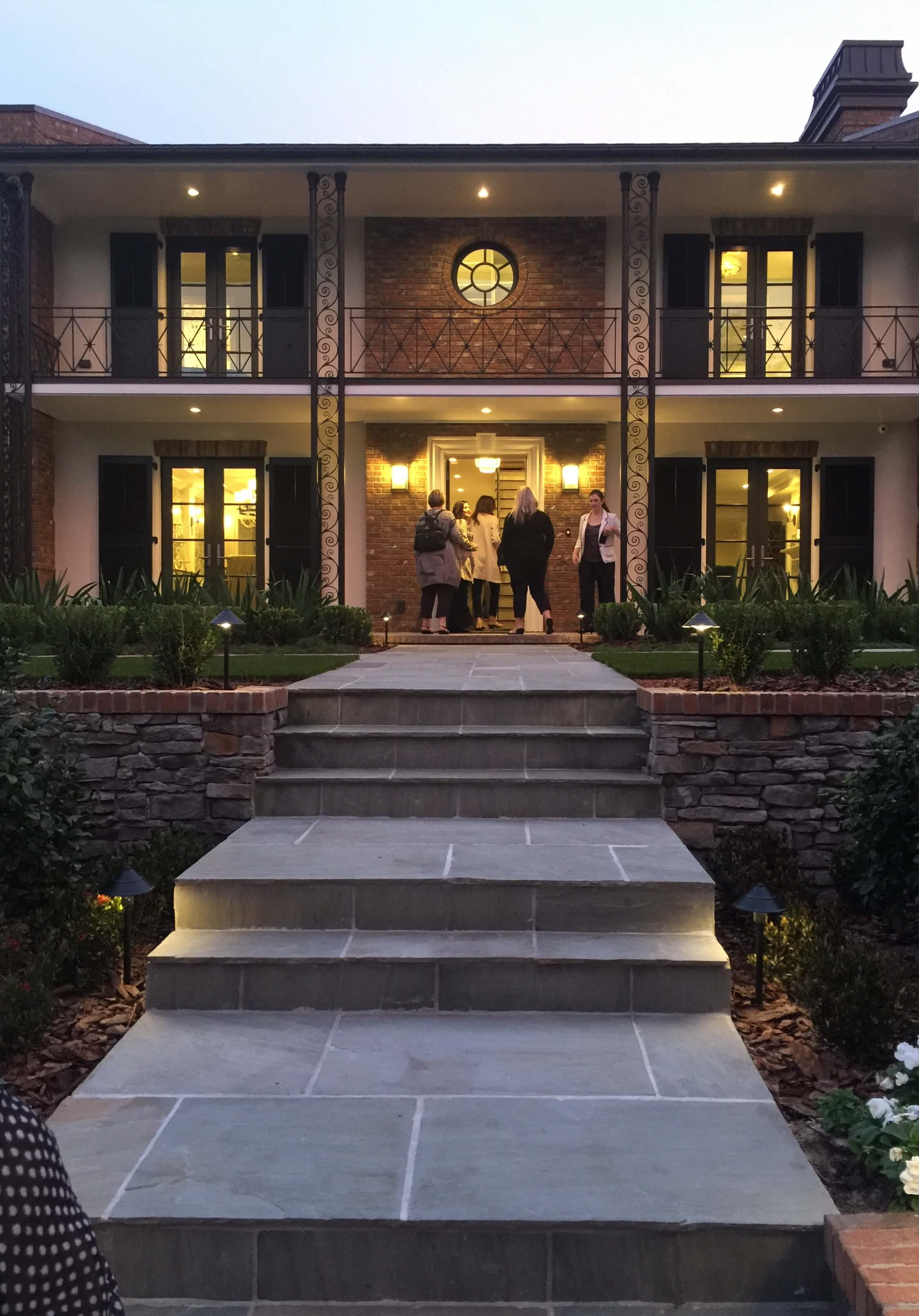 Our tour began at dusk. This home has such lovely curb appeal. #curbappeal #frontdoor #frontporch