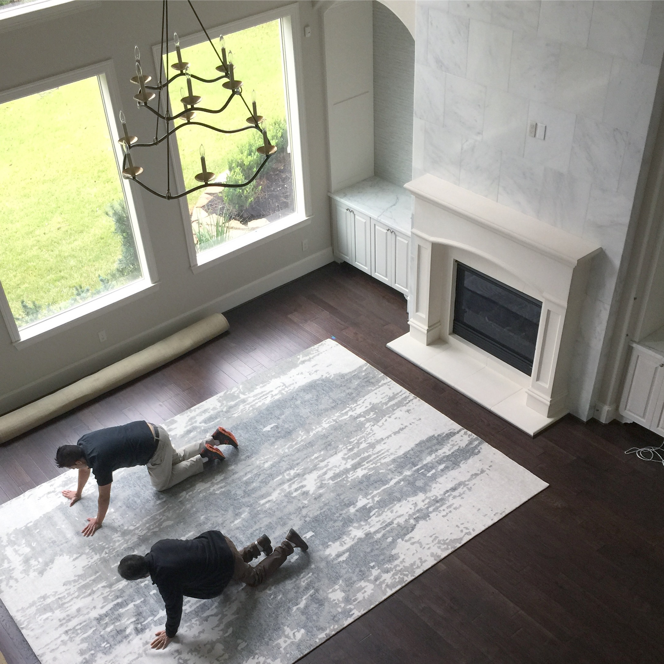 Rug installation in living room #livingroom #rug #livingroomdecor