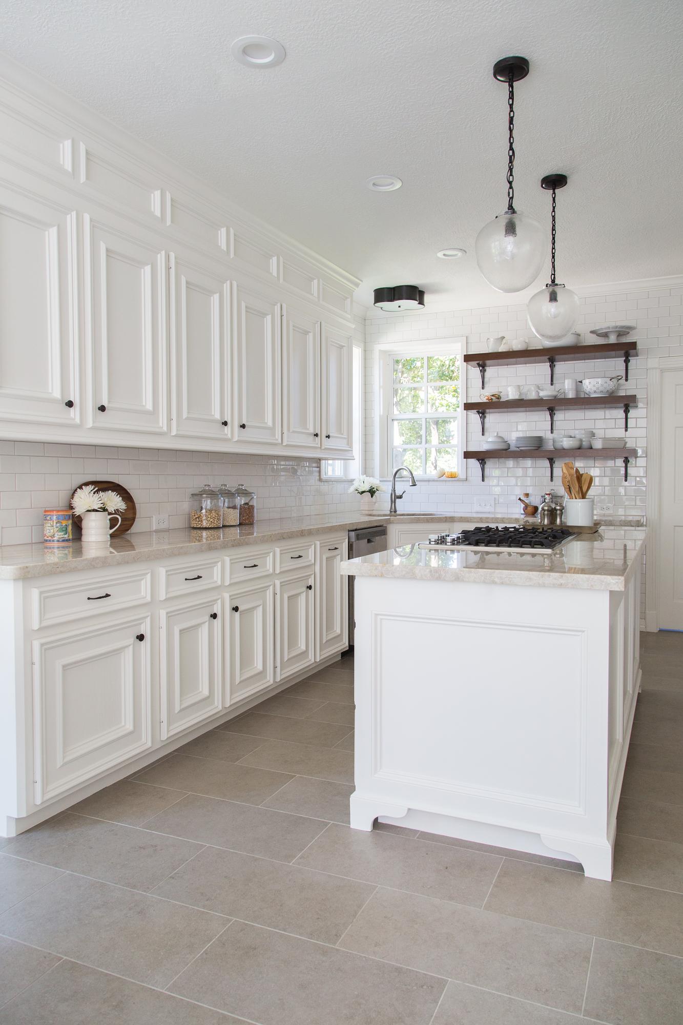 White kitchen remodel with open wood shelves - Designer: Carla Aston, Photographer: Tori Aston #whitekitchen #openshelving #quartzitecountertops