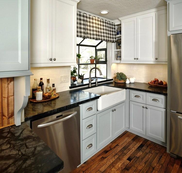 Kitchen remodel with two tone cabinets - Designer: Carla Aston, Photographer: Miro Dvorscak #farmsink #gardenwindow #kitchenremodel #greyandwhitekitchen #soapstone