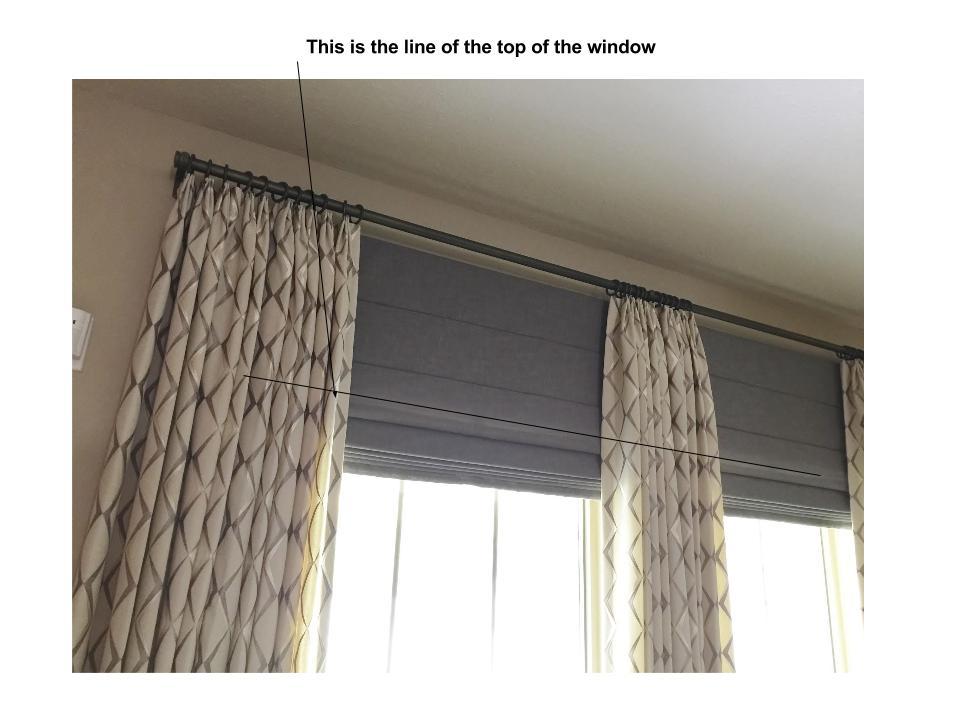 Drapery with shade mounted just under the rod to make window appear taller