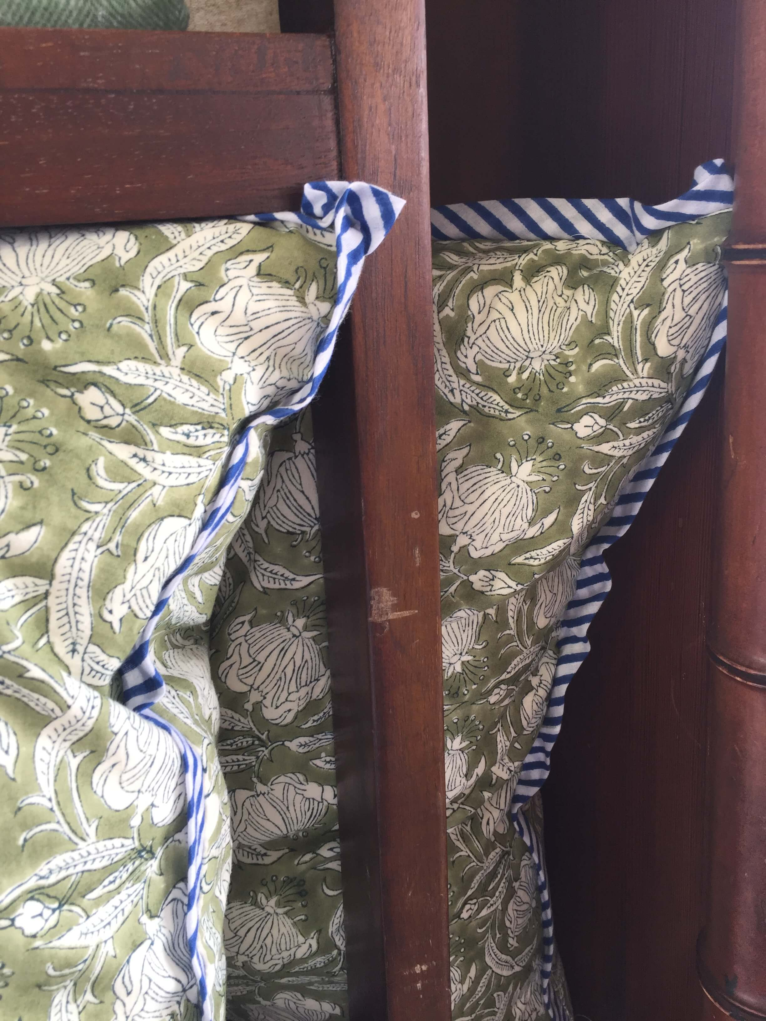Cotton print textiles made into pillows with flange details seen at Round Top, TX at Arbor Antiques from Mela and Roam #pillows #antiques #roundtop #textiles