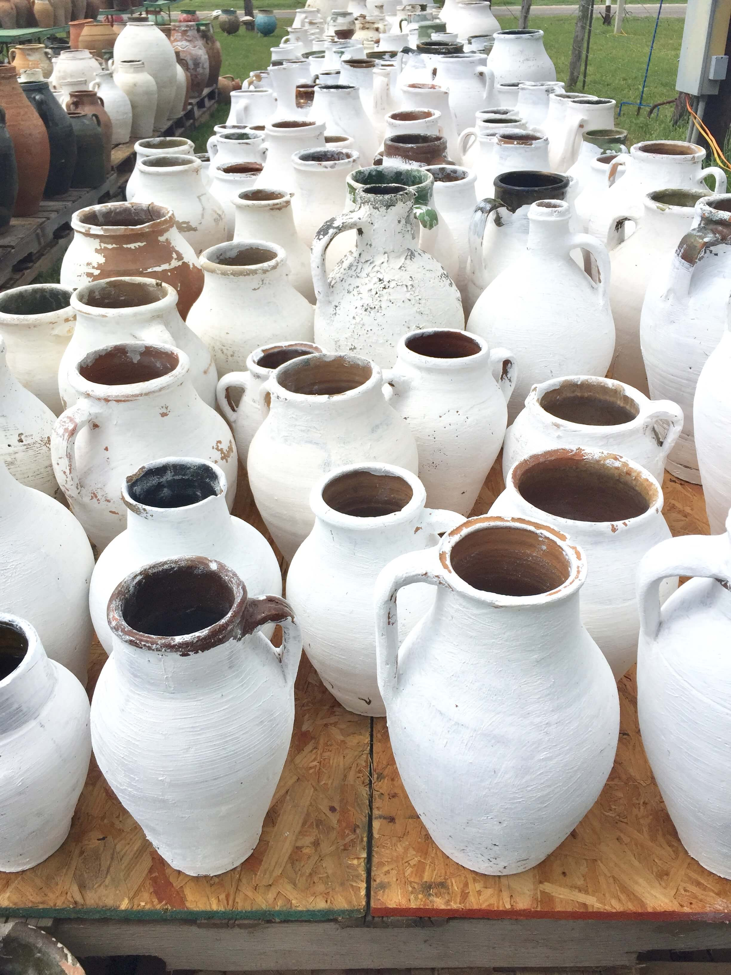 Antique olive jars painted white seen at Roundtop, TX #vases #olivejars #roundtop