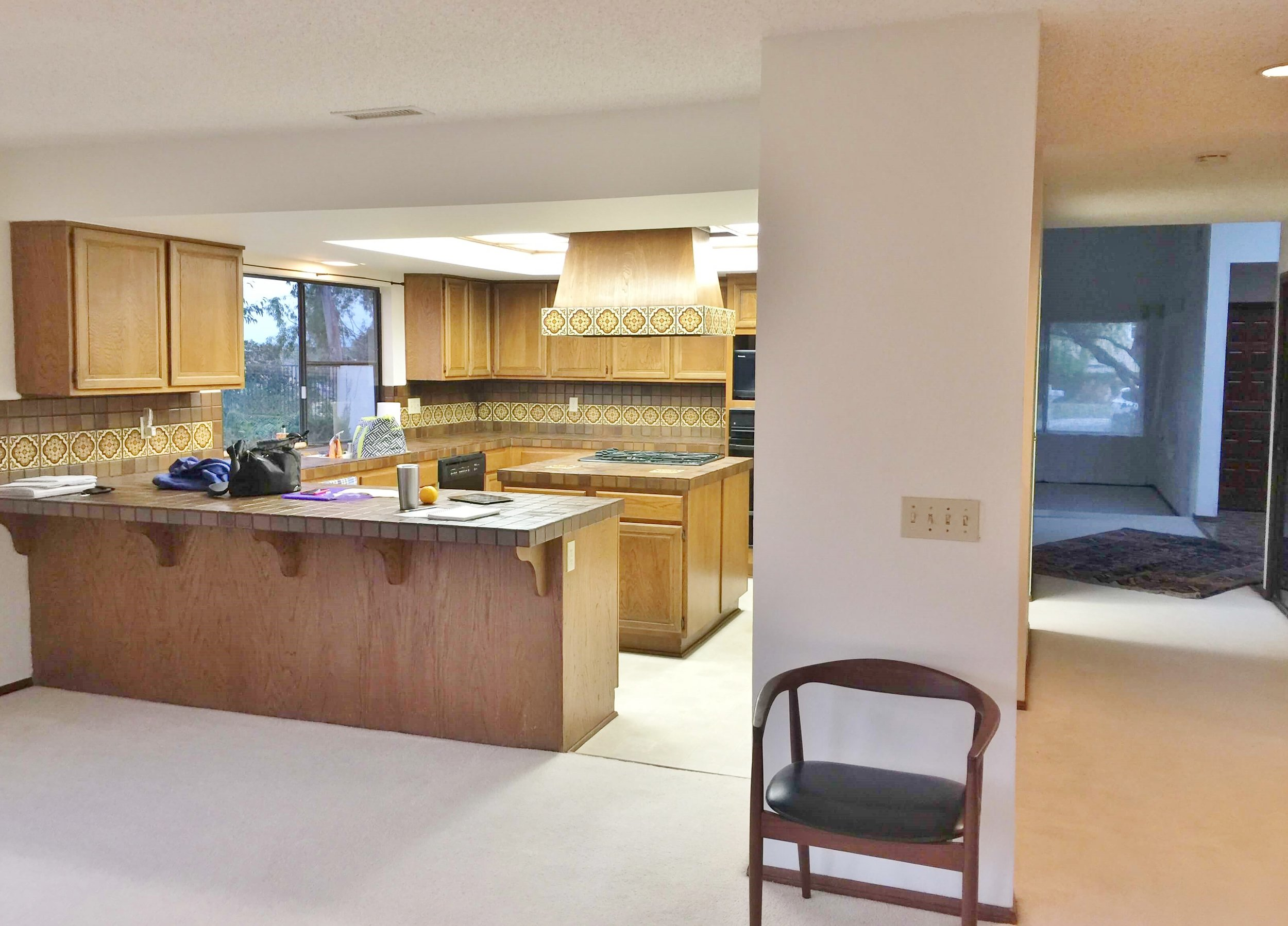 Before image of kitchen to be remodeled with brown wood cabinets