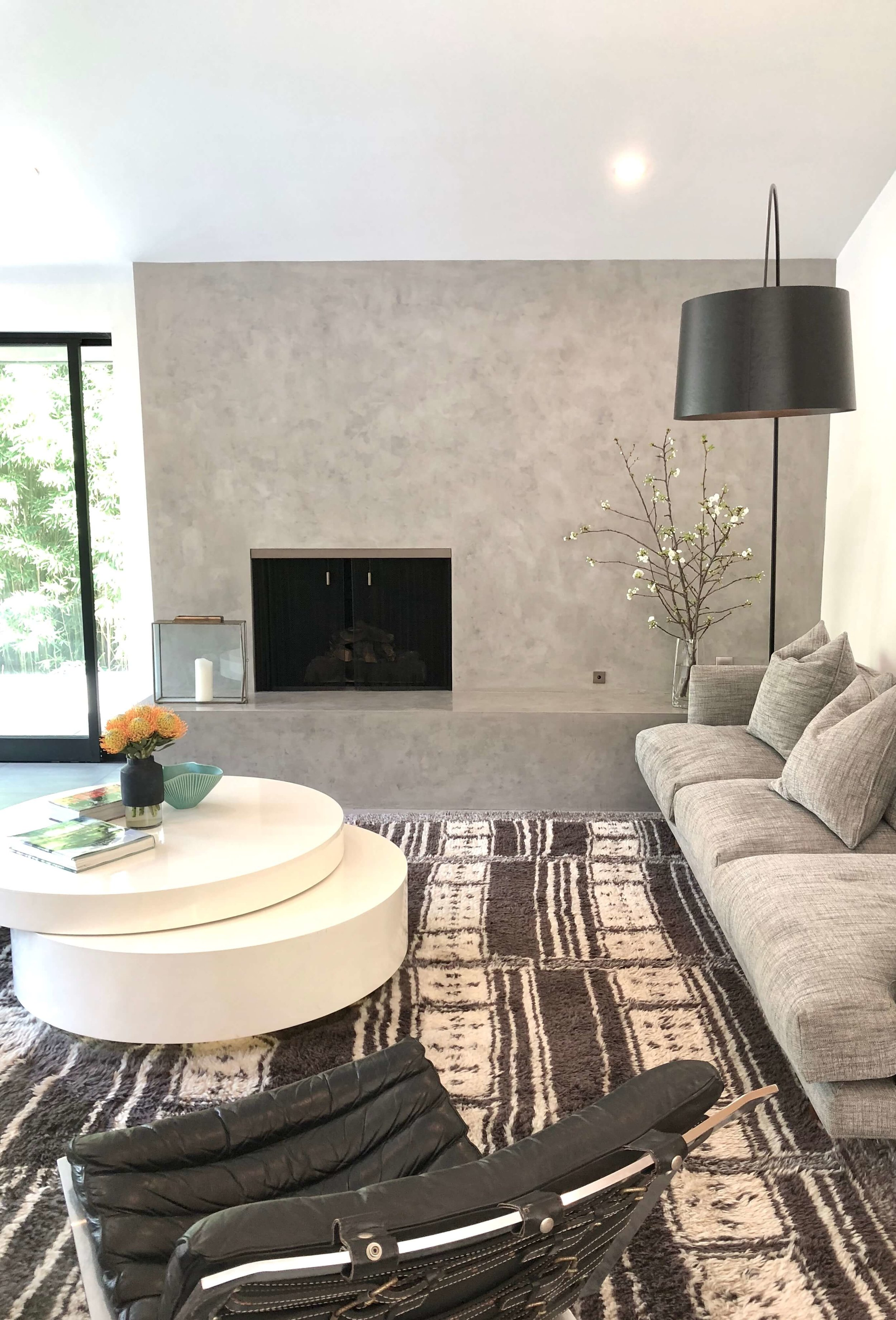Living room with concrete look fireplace - Assembledge+ Architects, Dwell on Design, Los Angeles, California #concretefireplace #fireplace #livingroom