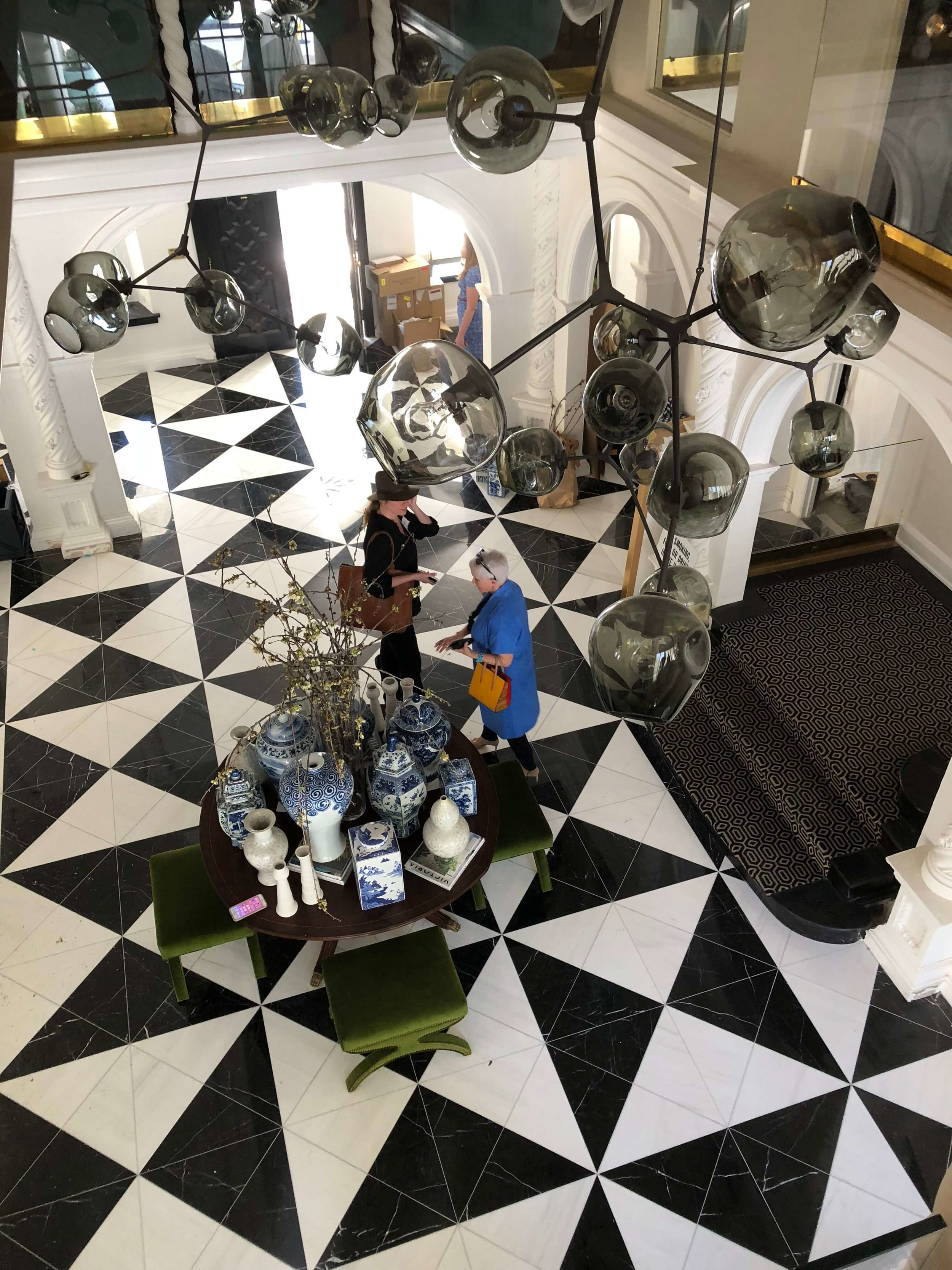 Black and white marble tile geometric floor in the entry hall of Pasadena Showcase House of Design Entry Hall - Designer: Amy Peltier