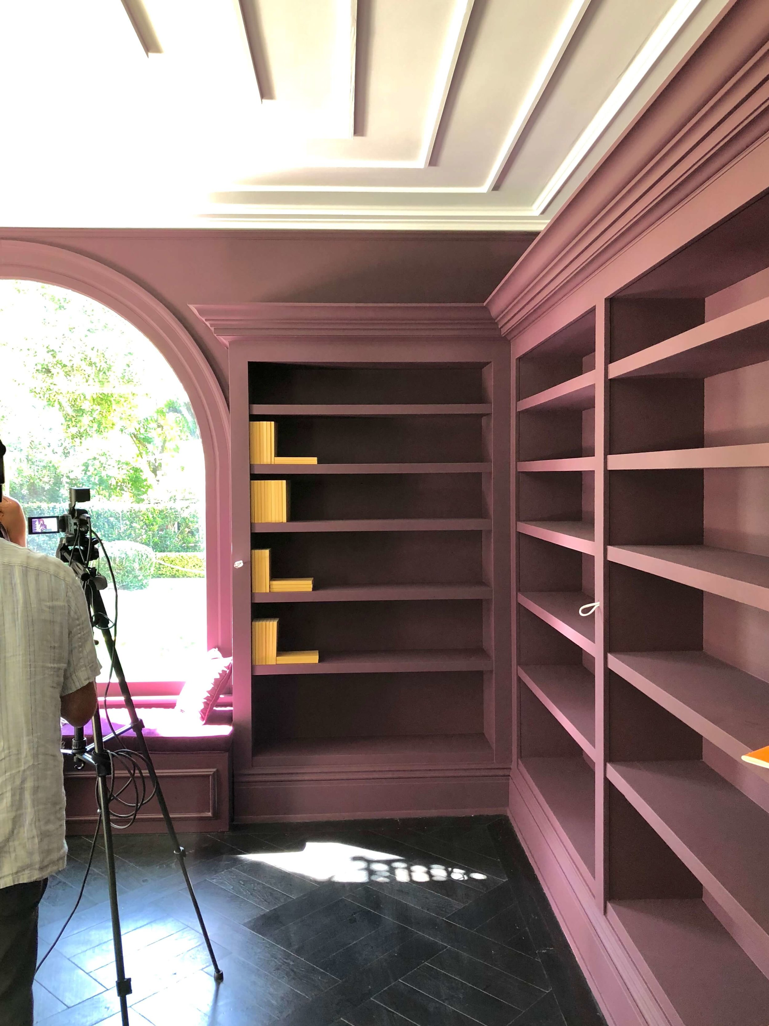 Library designed by Dina Marciano at the Pasadena Showcase House of Design with purple walls and bookcases #purplewalls #library #libraryideas #purpleroom