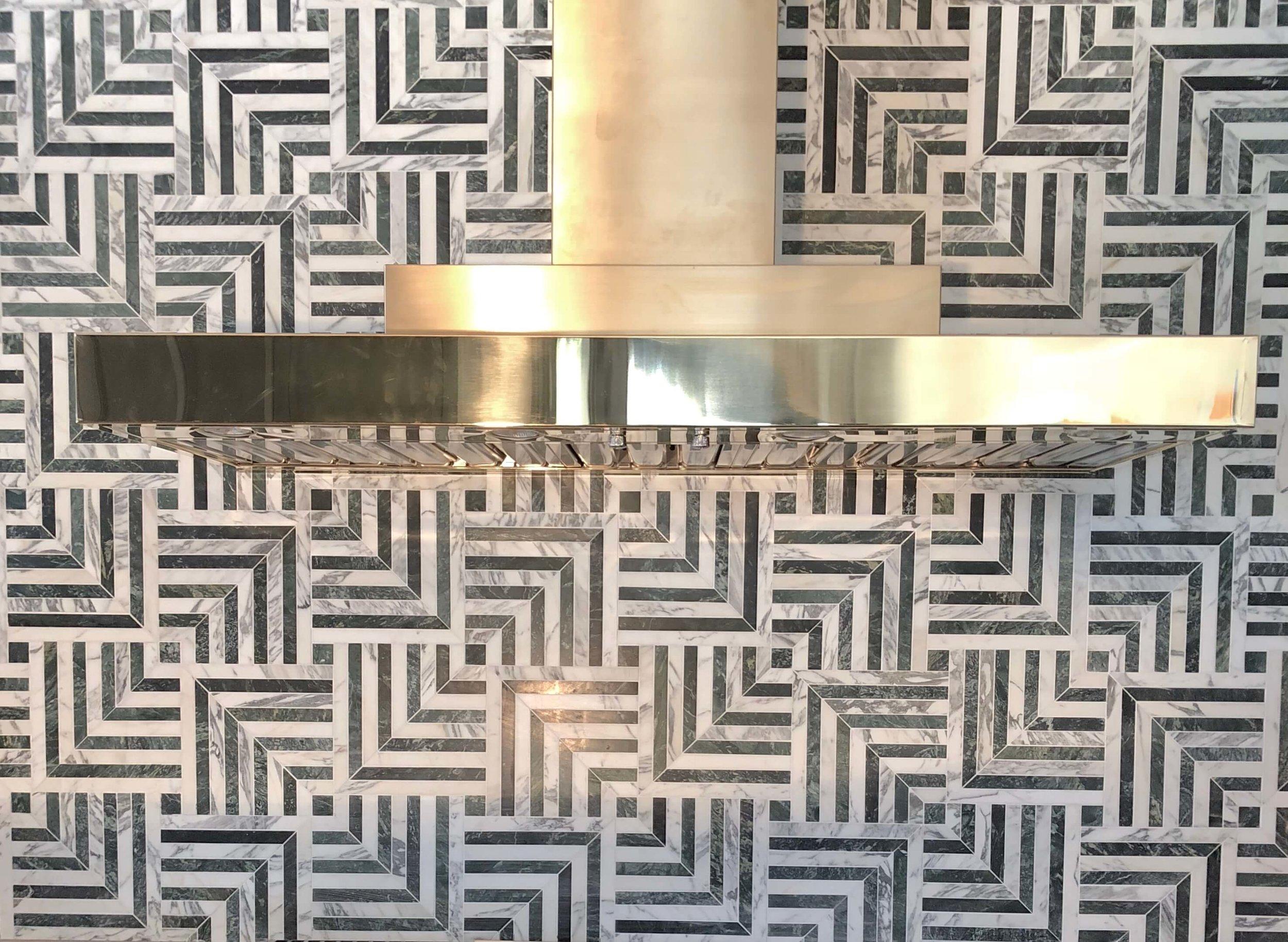 Marble mosaic tile backsplash with brass venthood - Kitchen designed by Jeanne K Chung #brass #venthood #marblemosaic #backsplash #marblebacksplash #kitchendesignideas